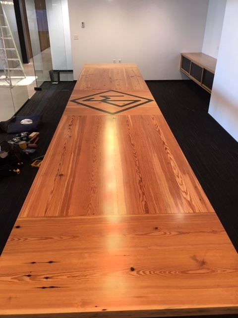 Reclaimed pine conference table with steel and epoxy inlay.