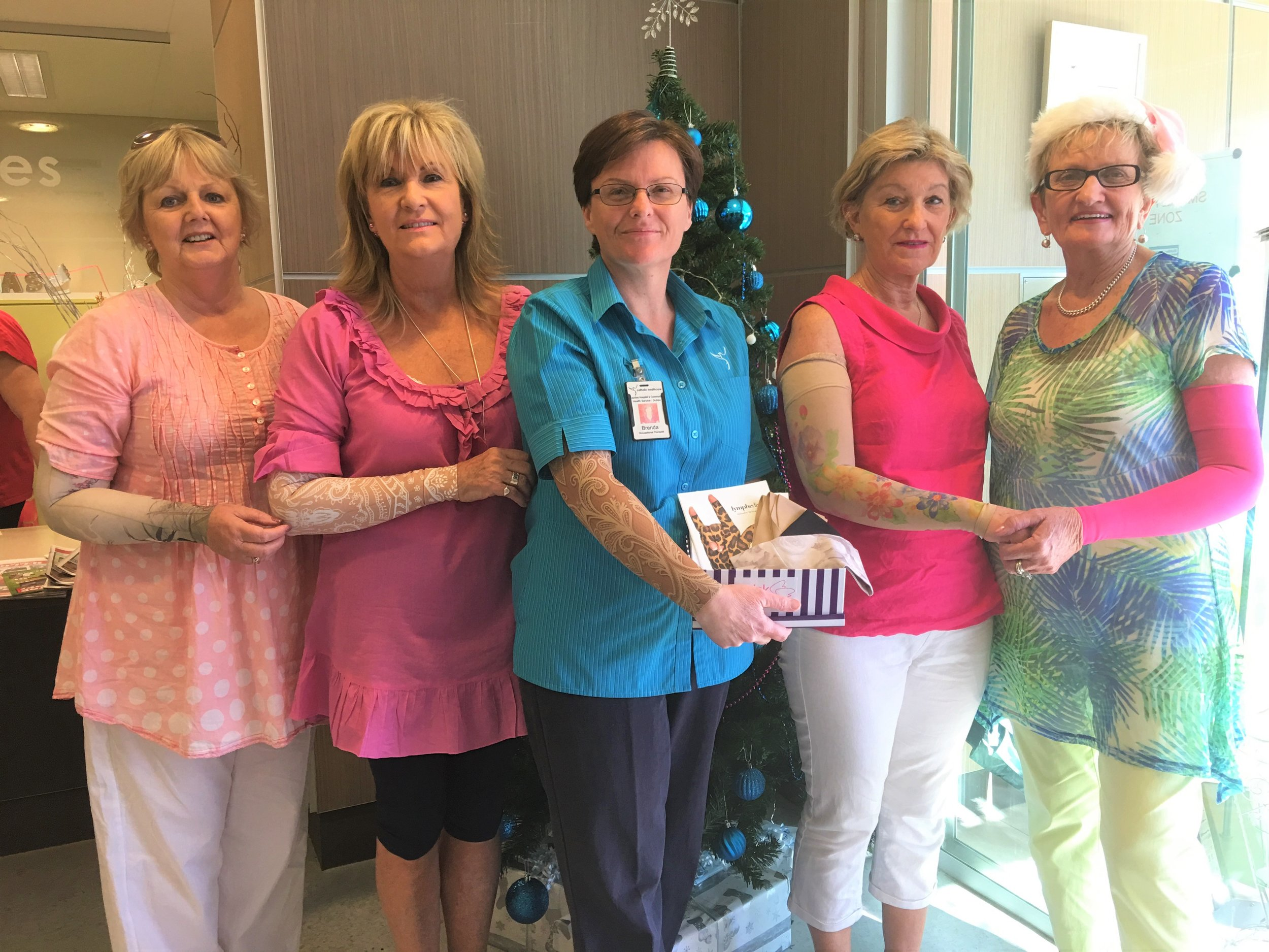 Pink Angels-Margo, Sue, Chris & Pam-donating compression sleeves for patients to Lymphedema Nurse, Brenda, at Lourdes Hospital.