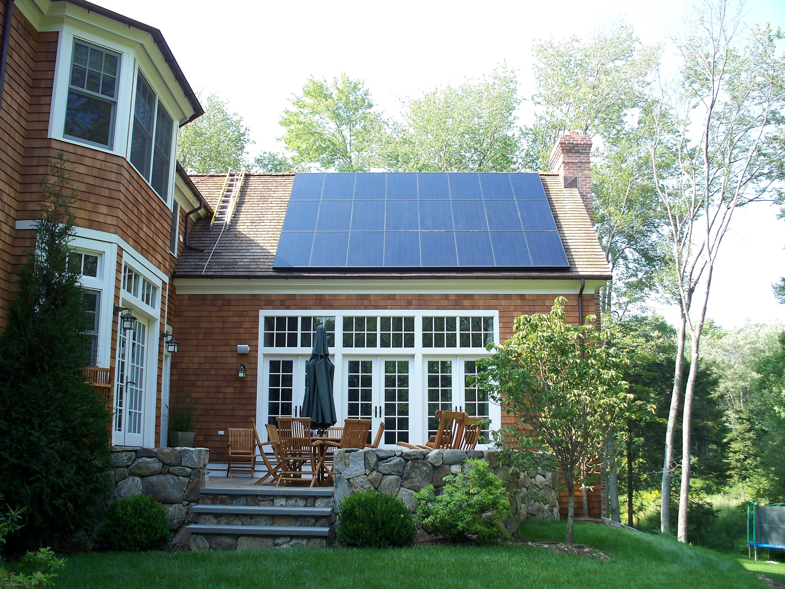 stock-photo-roof-with-solar-panels-fragment-82734334.jpg