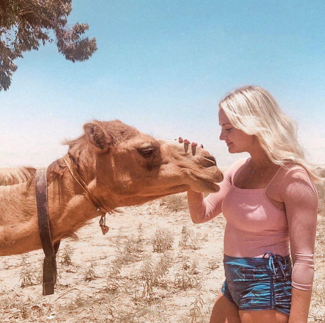 We found a camel in the desert—dream come true!