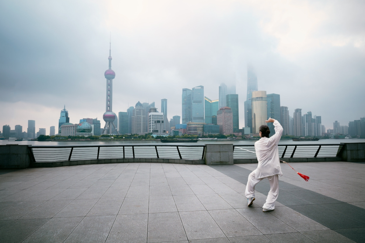 Beautiful view of Shanghai Skyline at sunrise with people doing Tai Chi. Shanghai China By Patrick Foto adobe spark