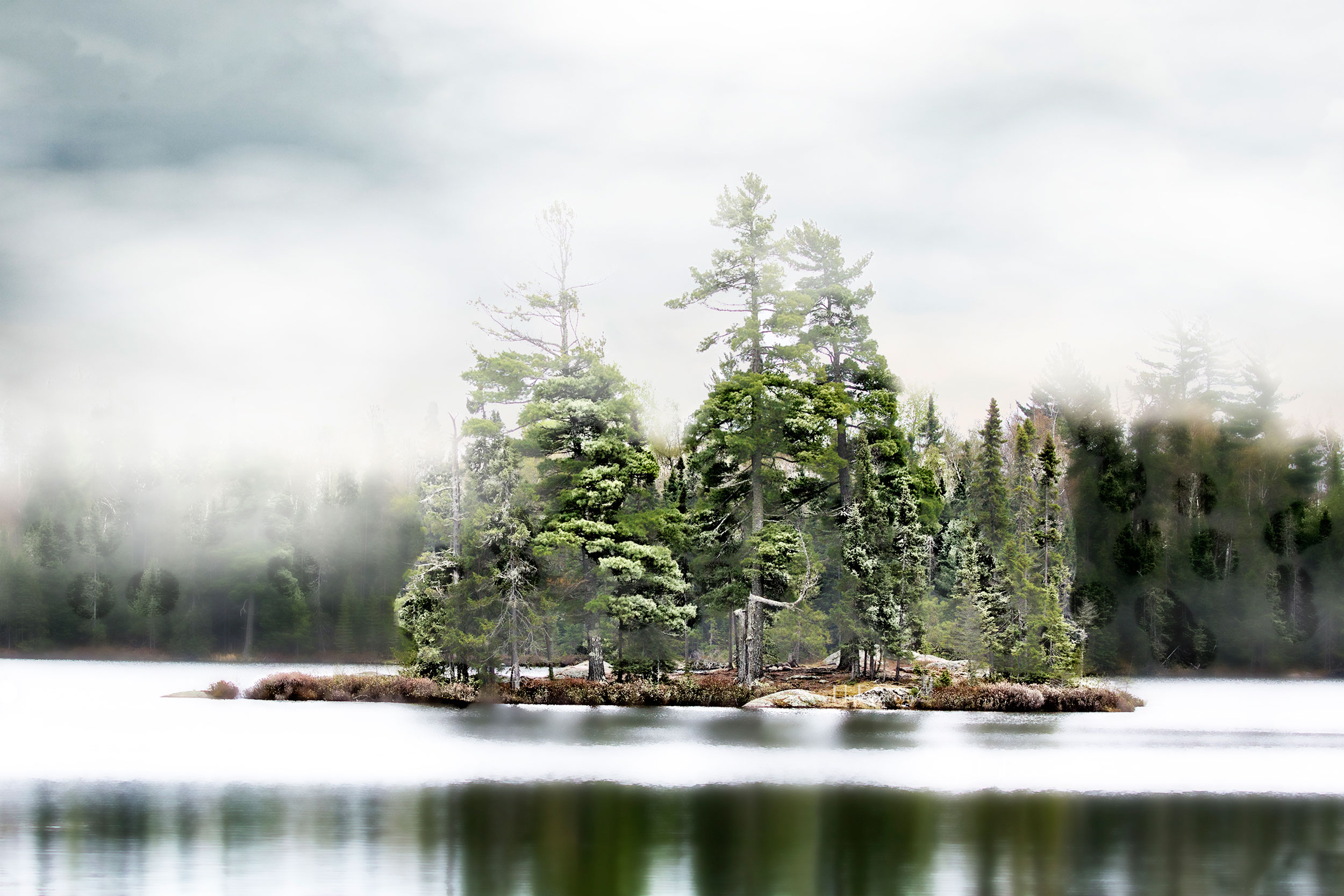 The beautiful photographs of the Boundary Waters throughout this site are by RoyMisonznick
