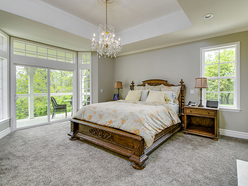 Sleep like a queen in your king sized bed under a chandelier