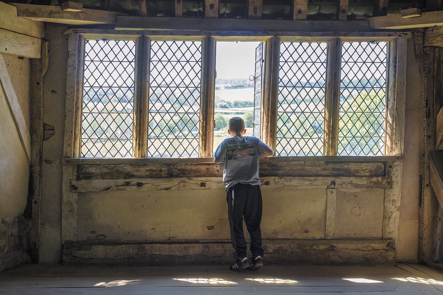 Matthew looking out of the window at Stokesay Castle May 6 2018.jpg