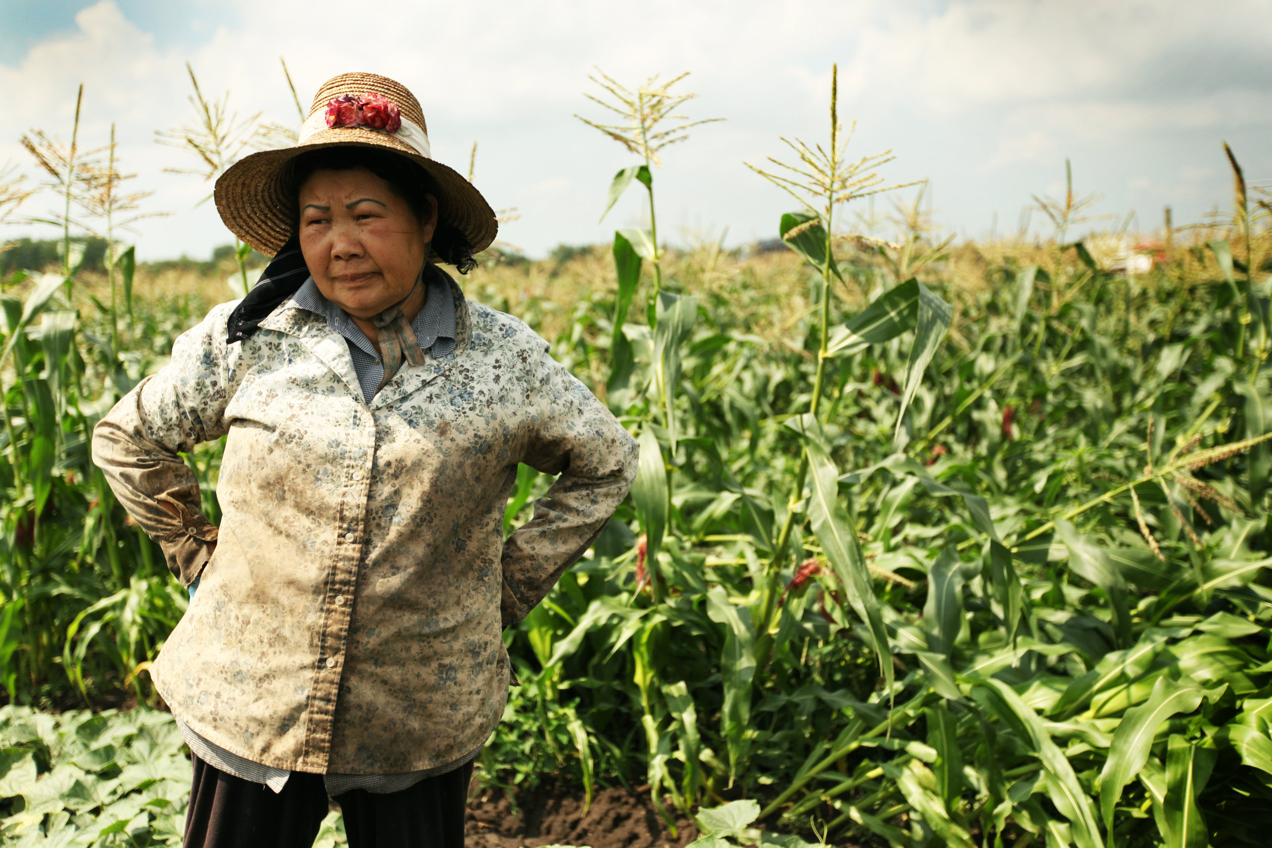 Judy Yang, Hmong farmer, spends a moment with us on her field to take short break.