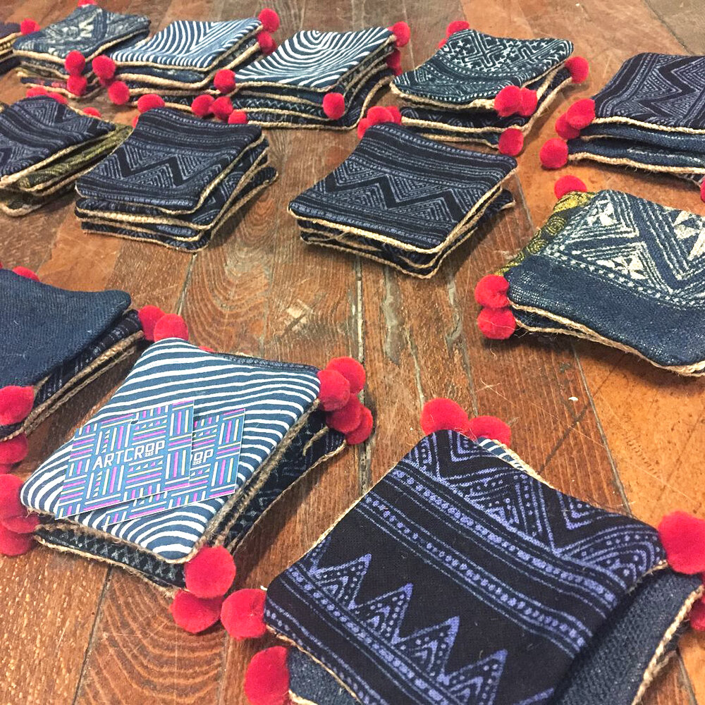 Oskar Ly created 50 sets of unique coasters using indigo-dyed batik textiles sourced from Hmong artisans from Southeast Asia.