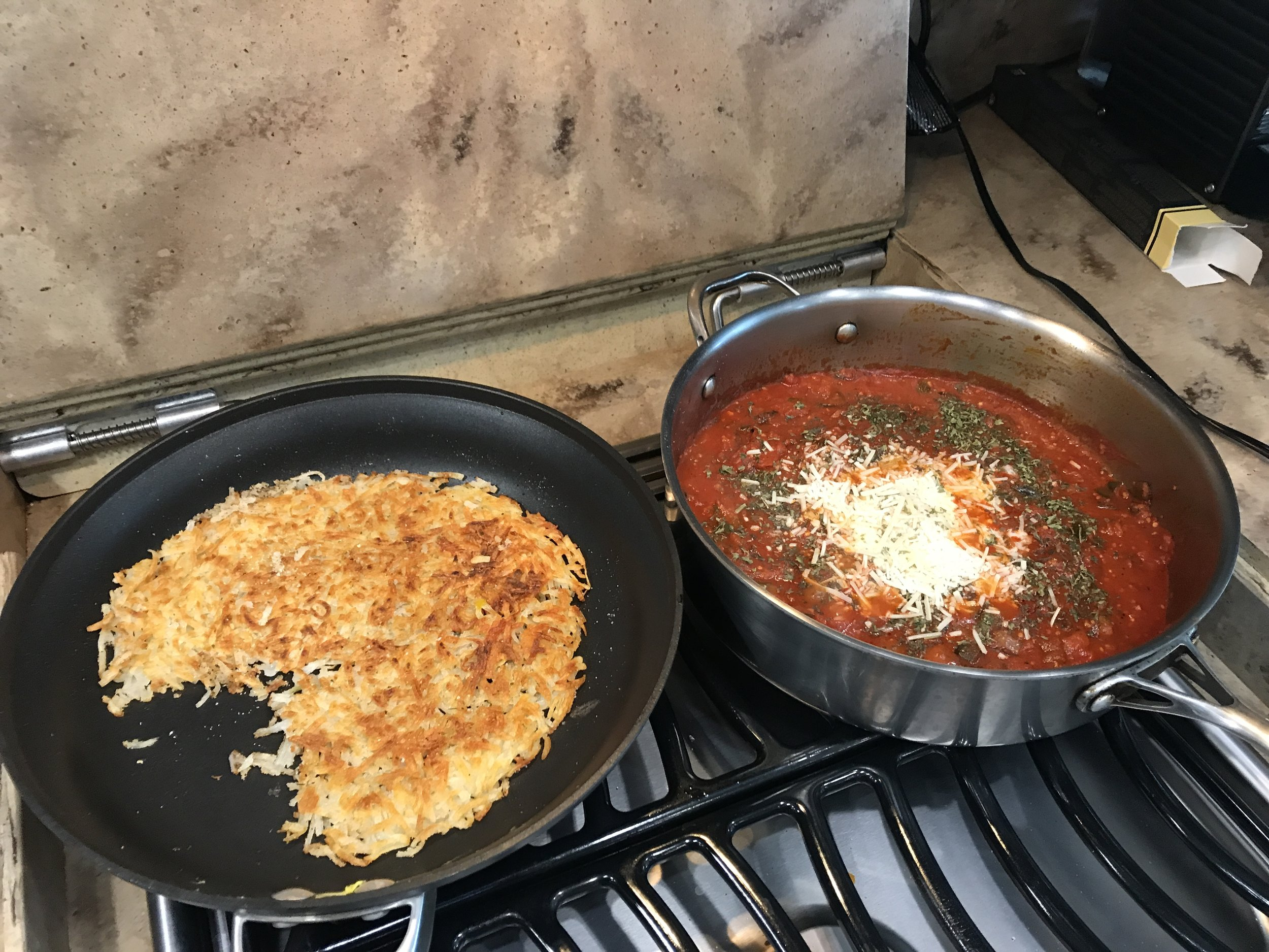 Delicious breakfast of hash browns and shakshouka  to give us energy for the day