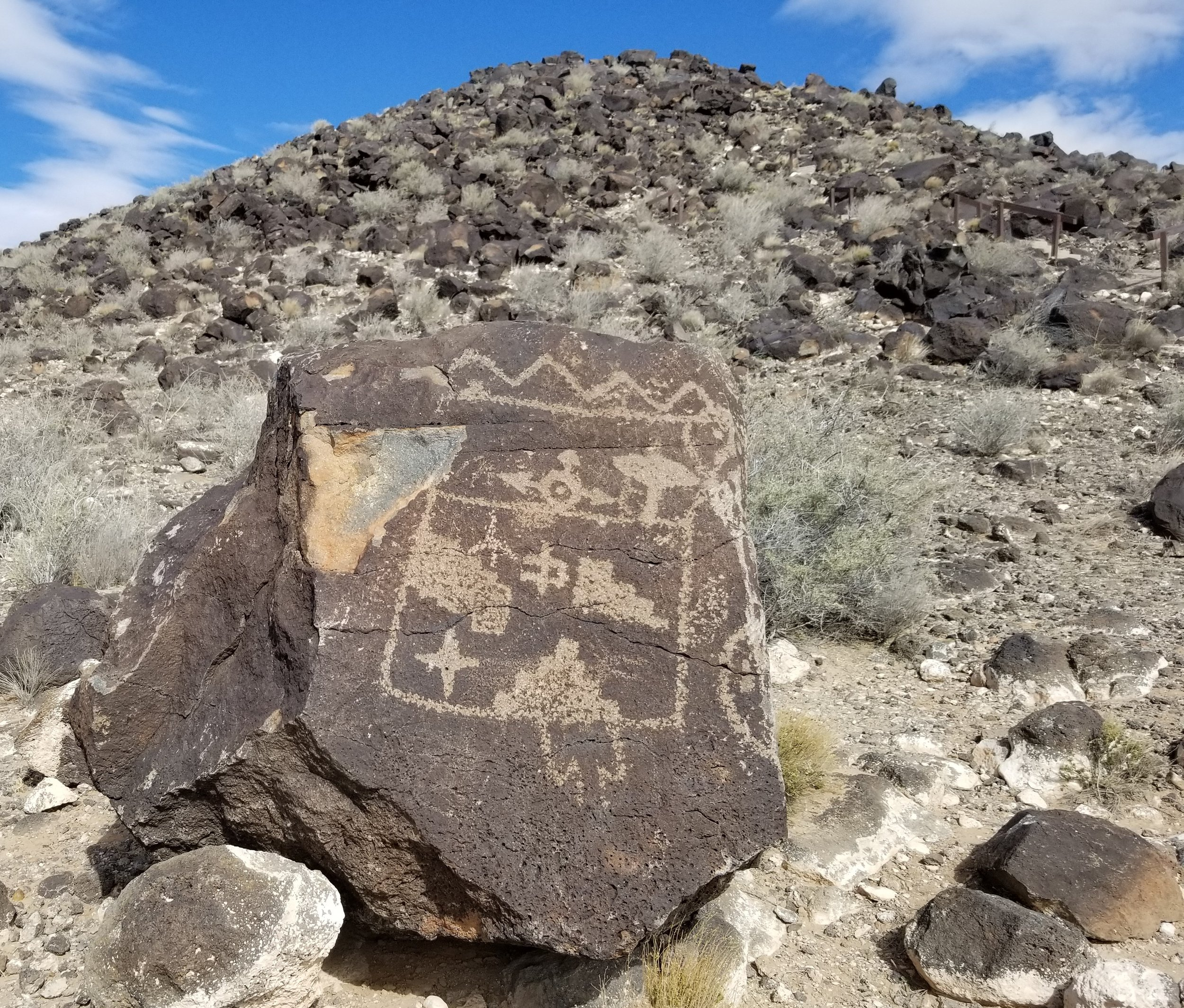 """Boca Negra Canyon, which according to the sign on the hiking trail """"is considered the birthplace of Petroglyph Monument."""""""
