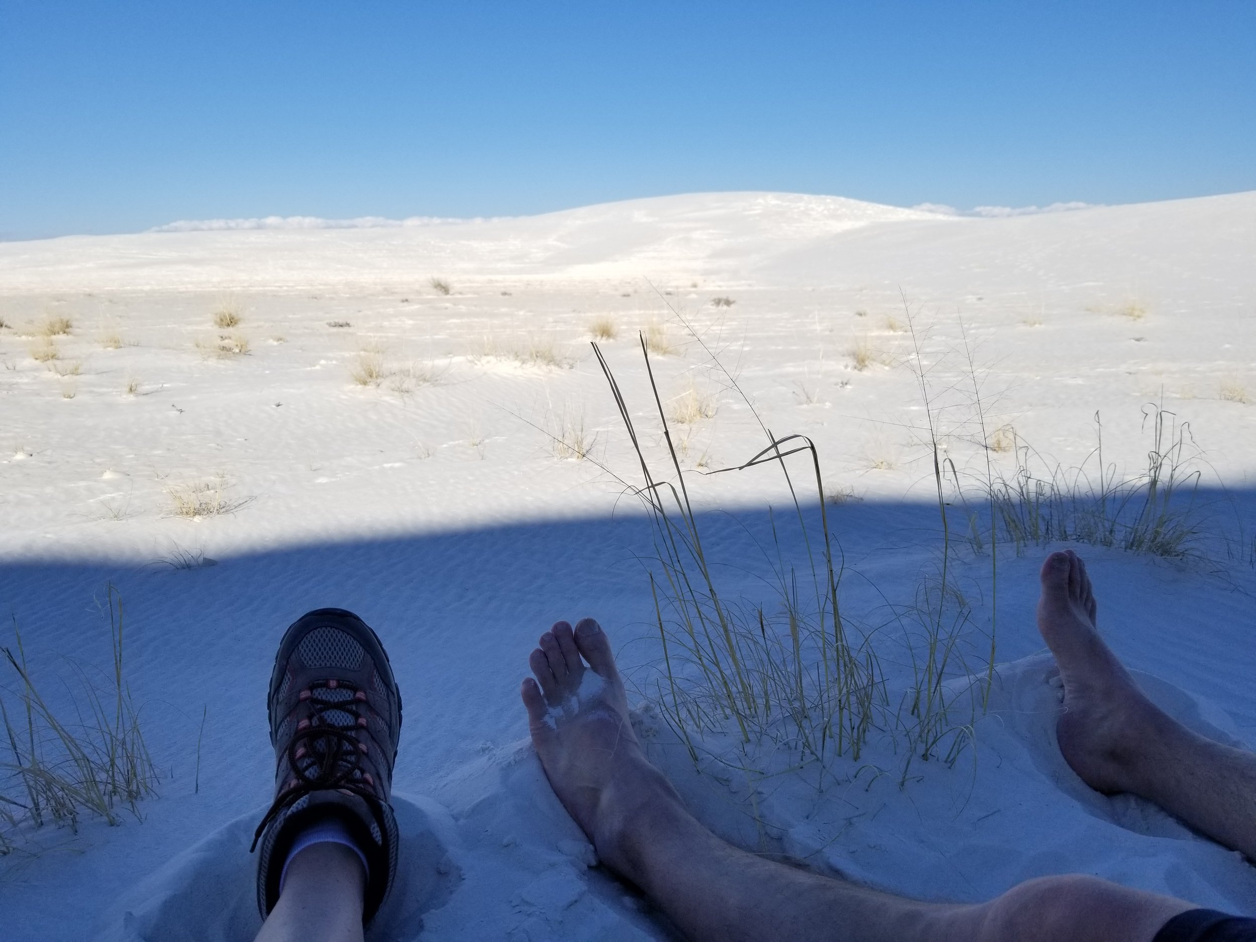 We found a shady spot on the back side of a dune and took a break. The sand was so cool. It felt awesome.