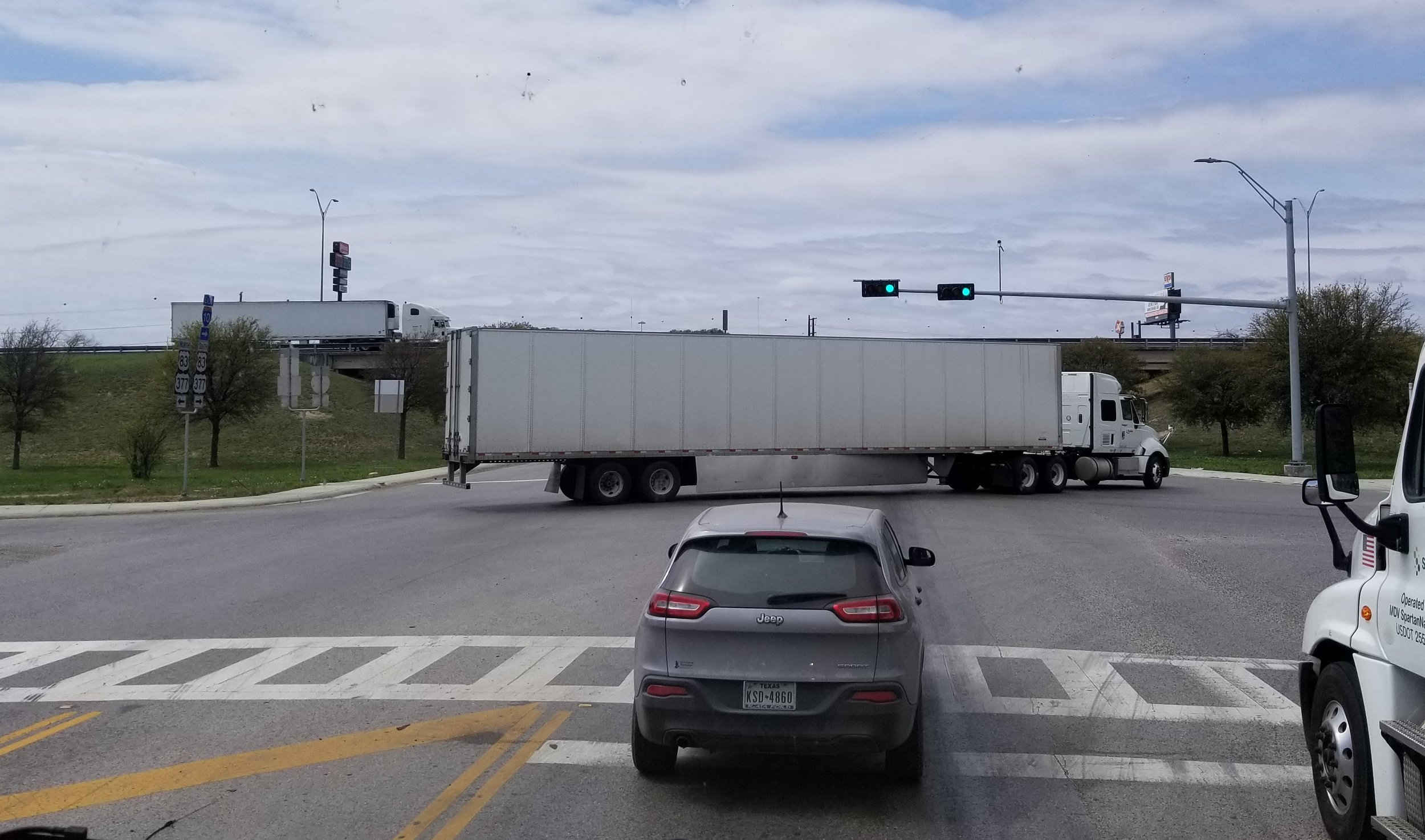 This poor bastard had his truck breakdown while turning and blocked the entire intersection.  We managed to find a hole big enough to make it around him.