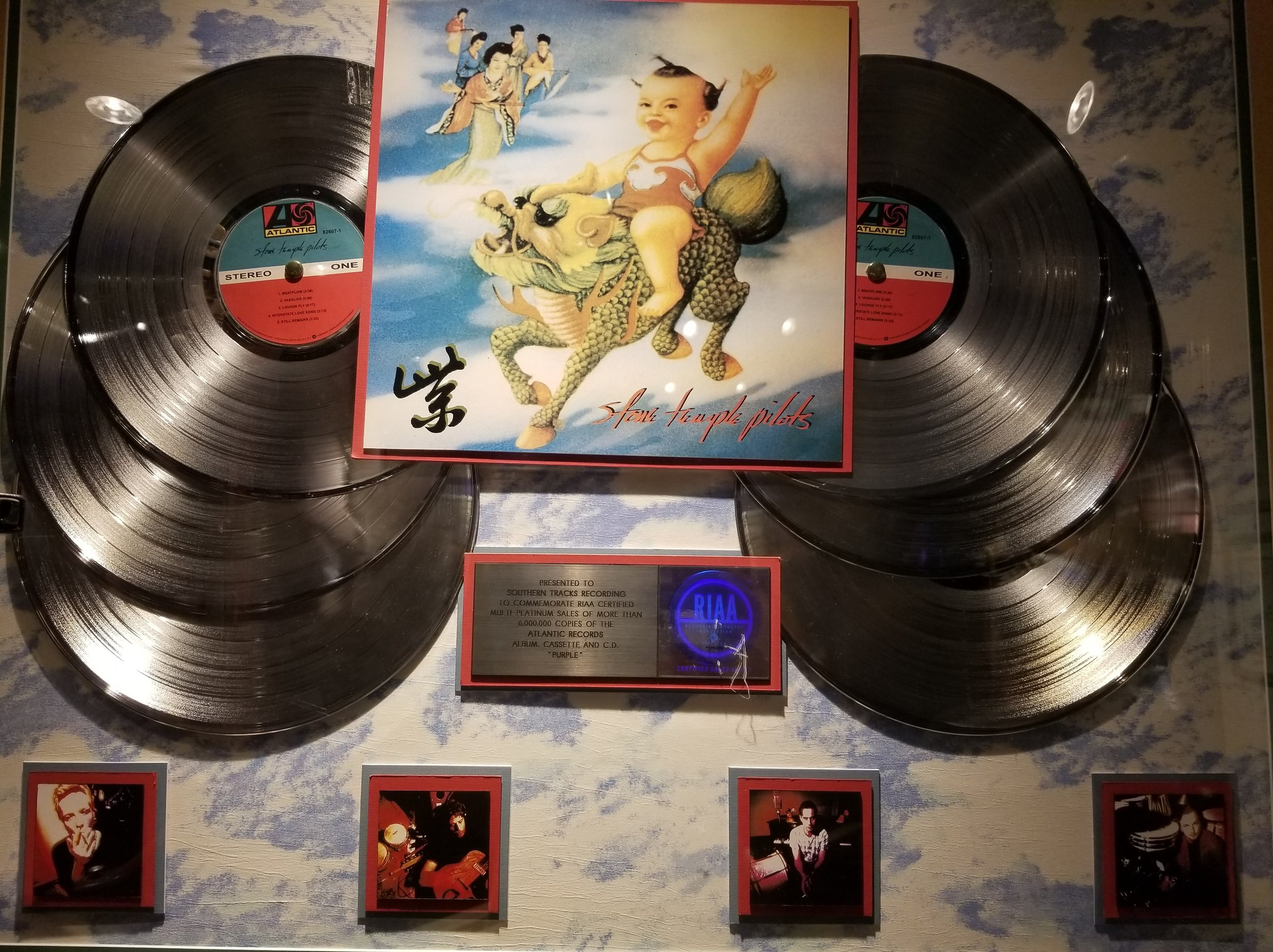 """Multi-platinum sales of more than 6,000,000 copies of the Stone Temple Pilots album """"Purple."""" All of the Gold and Platinum records in the museum were the original awards. Gold record albums in the U.S.A were presented when units exceeded 500,000 in sales and Platinum for sales over one million. Platinum and Gold status is different from country to country according to population"""