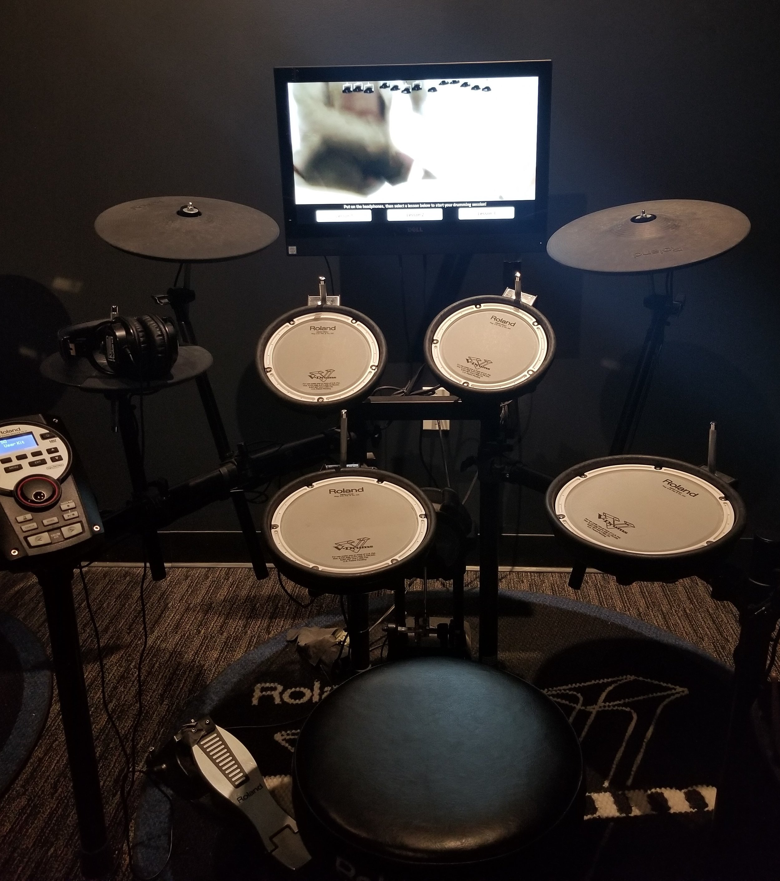 There were multiple rooms with various instruments. This was the drum room. There was an interactive screen that would teach you how to play the drums. It was fun!