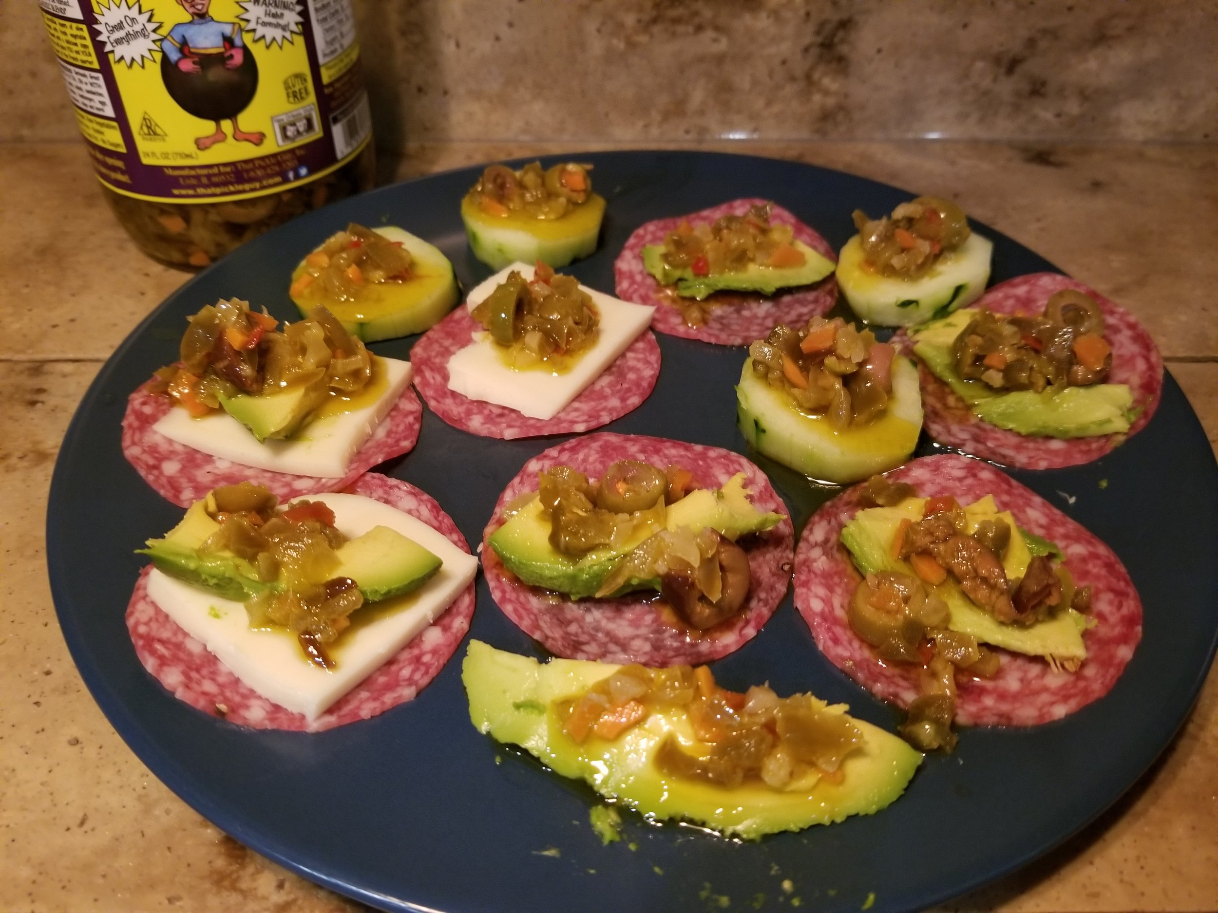 Delicious in lunch meat, cucumbers and Penguin likes it with a slice mozzarella