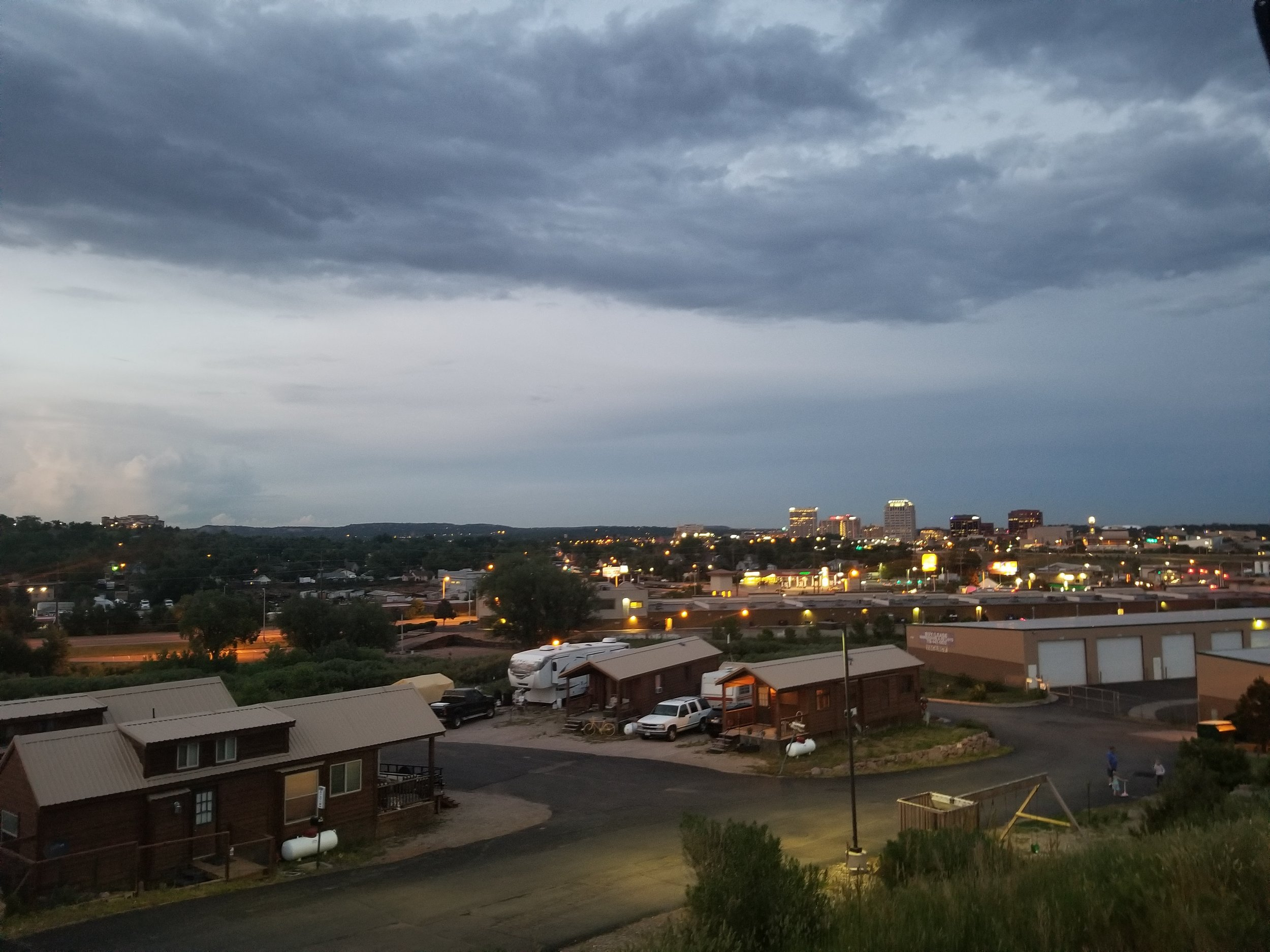 Overlooking the RV park from our spot up high, the city and storm clouds in the background. Video below captured the lightning in the clouds.