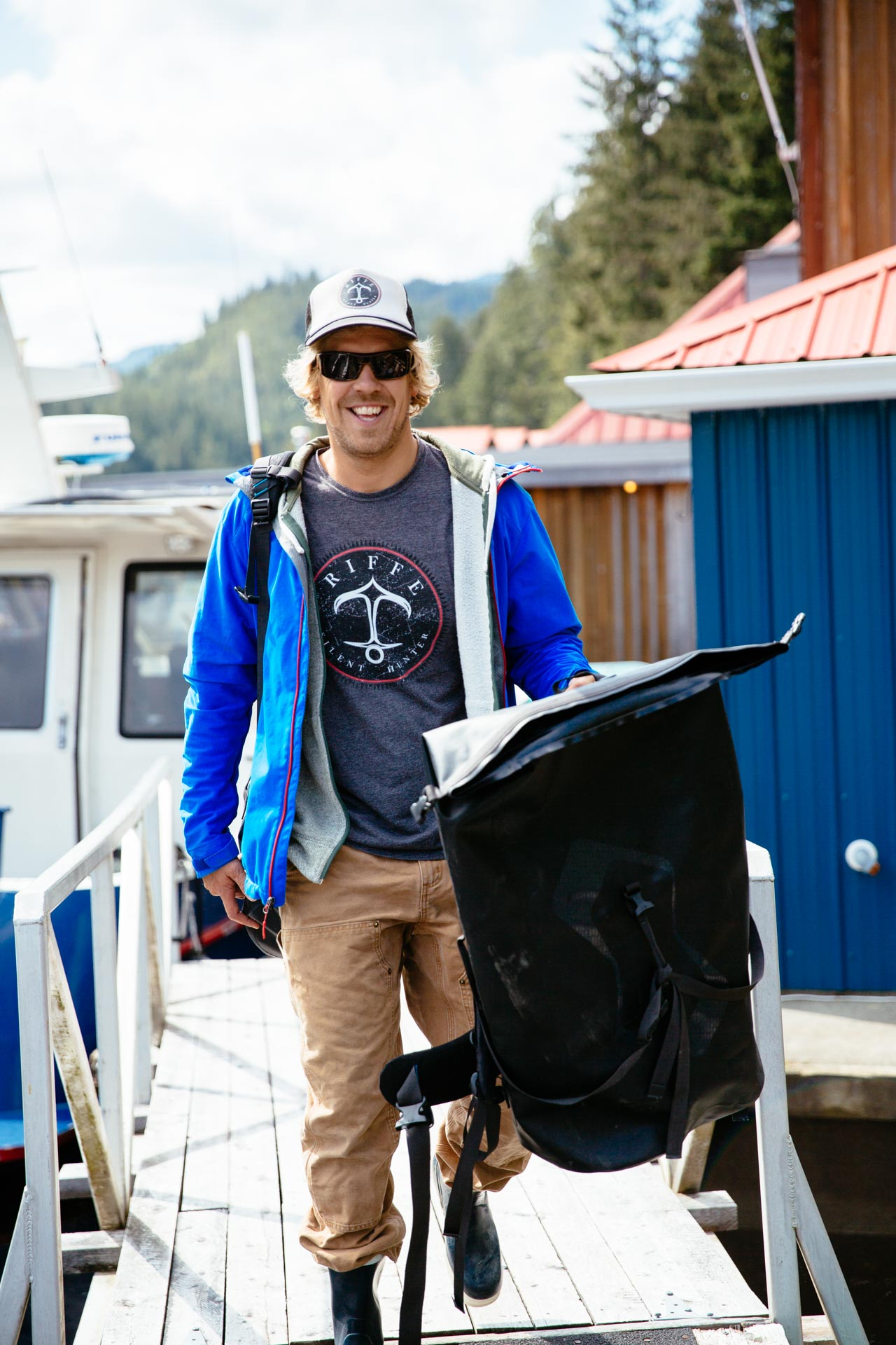 Chris Adair, Owner/Operator of Bottom Dwellers Freediving loading the boat at Nimmo Bay Resort with the crew. Photo: Jeremy Koreski