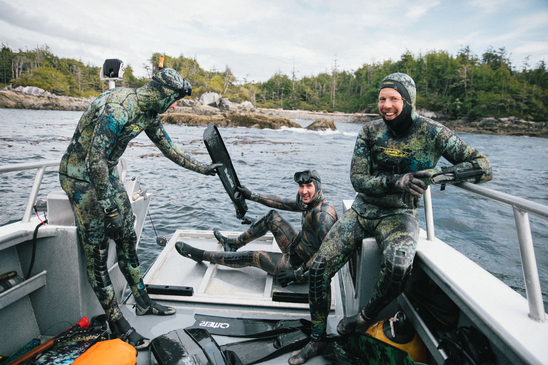 Chris Adair, Owner of Bottom Dwellers, on the right enjoying some laughs and good times exploring the rugged coast of BC with Nimmo Bay Resort and crew.