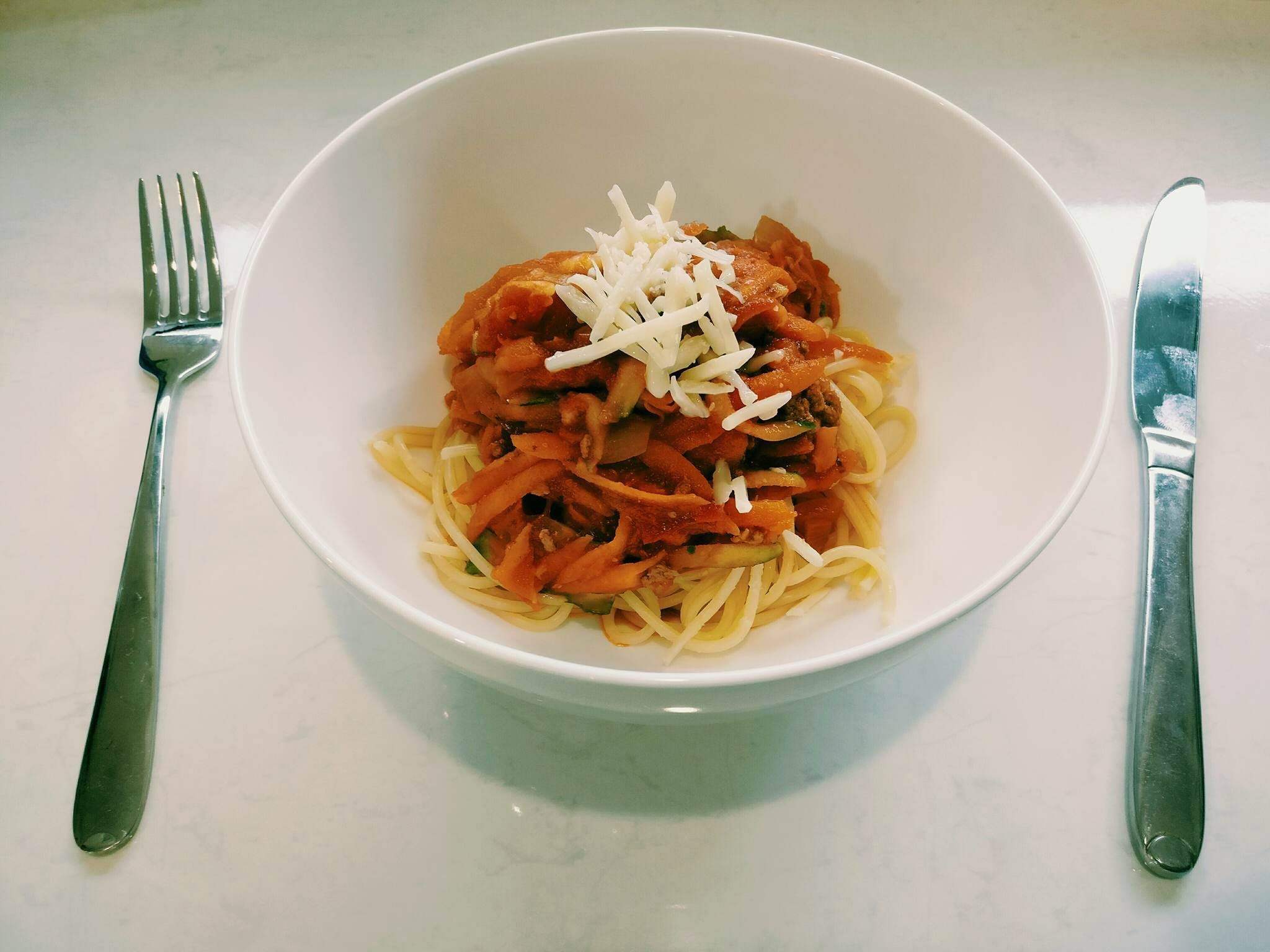 Spaghetti Bolognaise - Ingredients500g Dried Spaghetti300g Prime Beef Mince1 Onion - Diced3 Carrots - Grated1 Zuccini - Grated1x Tin Diced Tomatoes1x Jar Pasta SauceCheese (optional)Method1. Brown the mince and onion in a large frying pan2. Add the carrot and zuccini to the cooked mince and onion,cook through for 2-3 minutes3. Add the tinned tomatoes and pasta sauce, simmer until the sauce reduces4. Cook the dried spaghetti according to packed directions5. Serve mince mixture on top of cooked spaghetti and top with cheese (if using