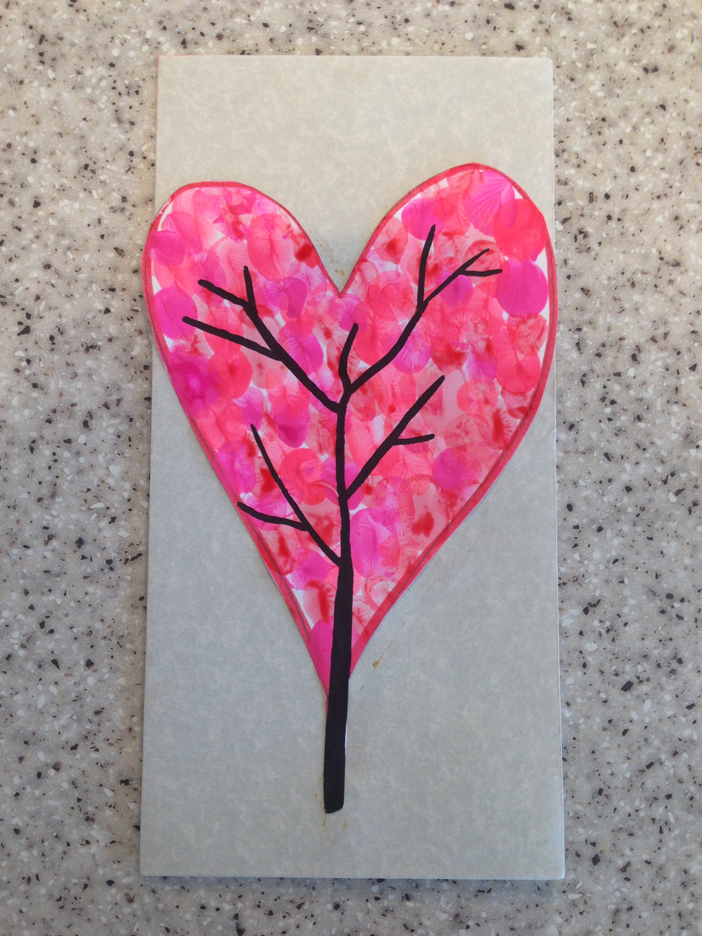 Fingerprint heart - Instructions1. Cut out a heart shape from a piece of card2. Using pink and red colored paint, let your little one use their finger prints to fill in the entire heart shape3. Draw a tree shape as shown in the photo **These are great to use as the front cover of a homemade card