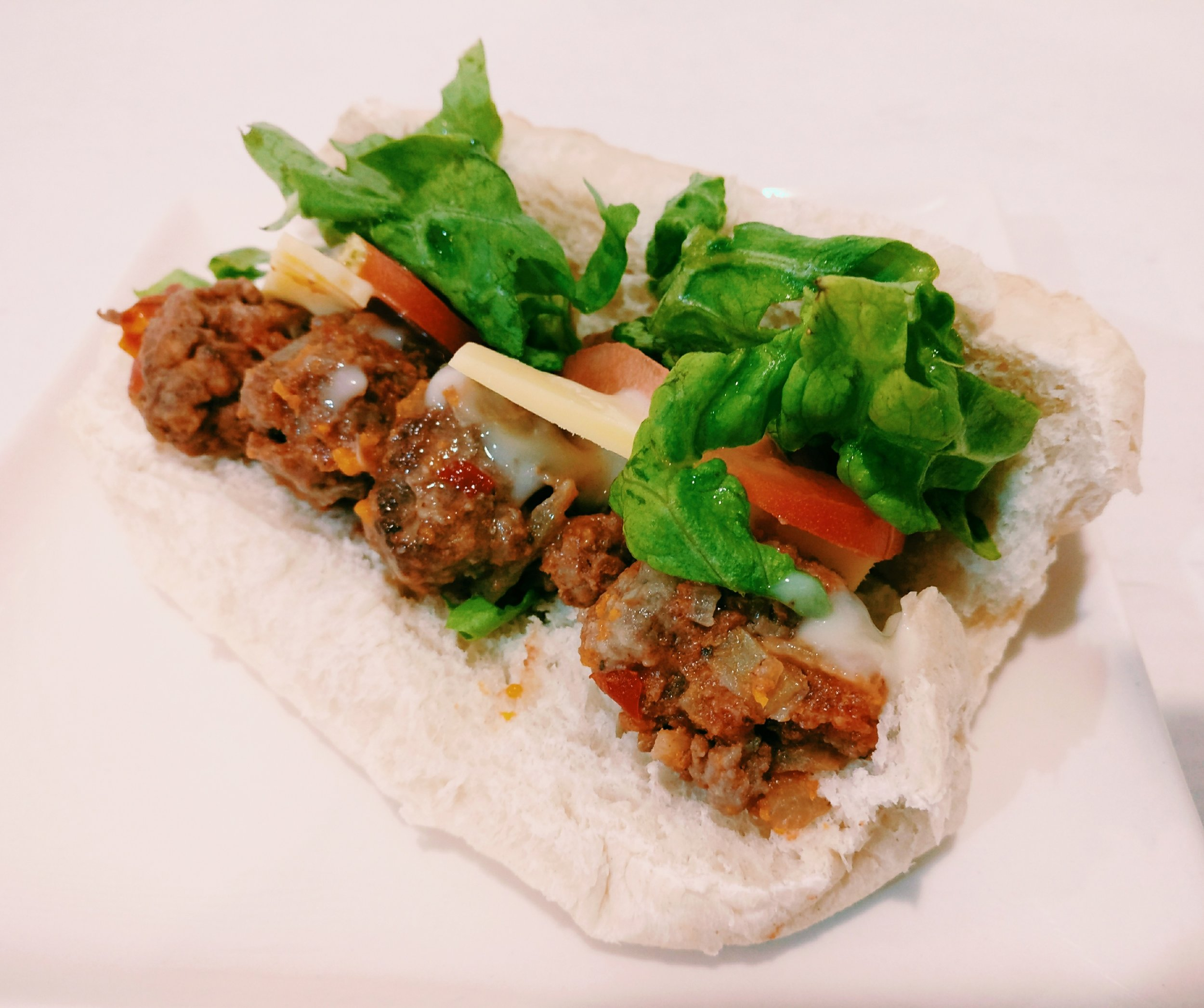 Meatball Subs - Ingredients500g Beef Mince1 Onion – diced1 Maggi Mushroom or Onion Soup Mix1 Egg1T Sweet Chilli Sauce (optional)1T Worcestershire Sauce (optional)1T Soy Sauce (optional)1T Tomato Sauce (optional)1t Mixed Herbs1 Tin – Diced TomatoesMethod1. In a large bowl, combine the mince, onion, soup mix, egg, tomato sauce, sweet chilli sauce, worcestershire sauce, soy sauce and mixed herbs2. Measure out tablespoon amounts of the mince mixture and roll into balls. Leave to set in the fridge for at least 1 hour3. Brown the meatballs in a large frying pan and when cooked though, add the tin of diced tomatoes and simmer for 2-3 minutes4. The meatballs can be served hot or cold on long rolls, topped with your favourite salad ingredients