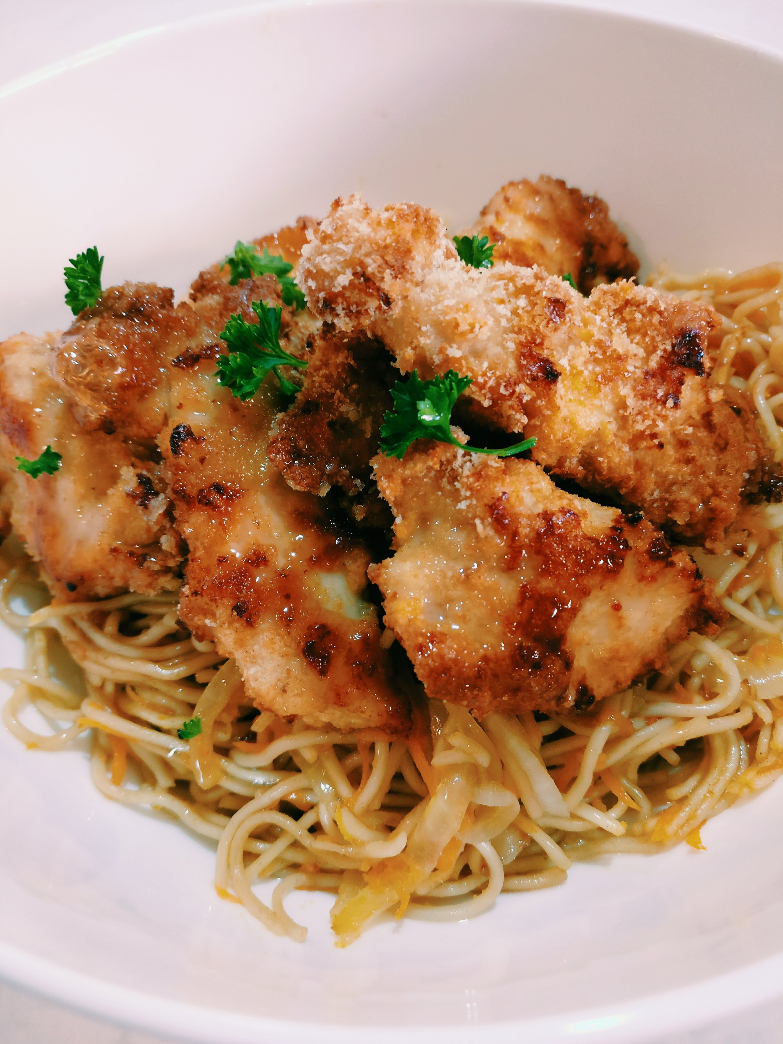 Crumbed Chicken & Noodles - Ingredients500g Chicken Breast1C Breadcrumbs2 eggs - Whisked2T oil280g Egg Noodles2T Oil (peanut oil preferred)1T Soy Sauce2 Carrots - Finely Grated1 Onion - Finely Sliced1/2C Water1/2C Malt Vinegar1/2C Sugar1 Garlic Clove1/2C Water2T Corn Flour1/2t Soy SauceMethod1. Slice the chicken breast into tender strips2. Dip the chicken tenders into the whisked egg and then into the breadcrumbs3. Place the chicken on a baking tray and cover lightly with oil, bake for 25-30 mins at 180 or until golden brown.4. Boil the egg noodles according to packet directions, once cooked; drain the noodles and fry them in the oil in a large frying pan for 2-3 minutes on a medium heat5. Add the soy sauce to the noodles along with the onion and carrot, cook for 2-3 minutes6. In a saucepan; add 1/2 water, malt vinegar, sugar and garlic clove and bring to the boil7. Combine the corn flour with the extra 1/2C water and soy sauce whisk with a fork. Add this to the saucepan and bring back to the boil until it thickens to the desired consistencyTo plate: place the egg noodles in a bowl, top with the crumbed chicken and finally top with the sweet and sour sauce.