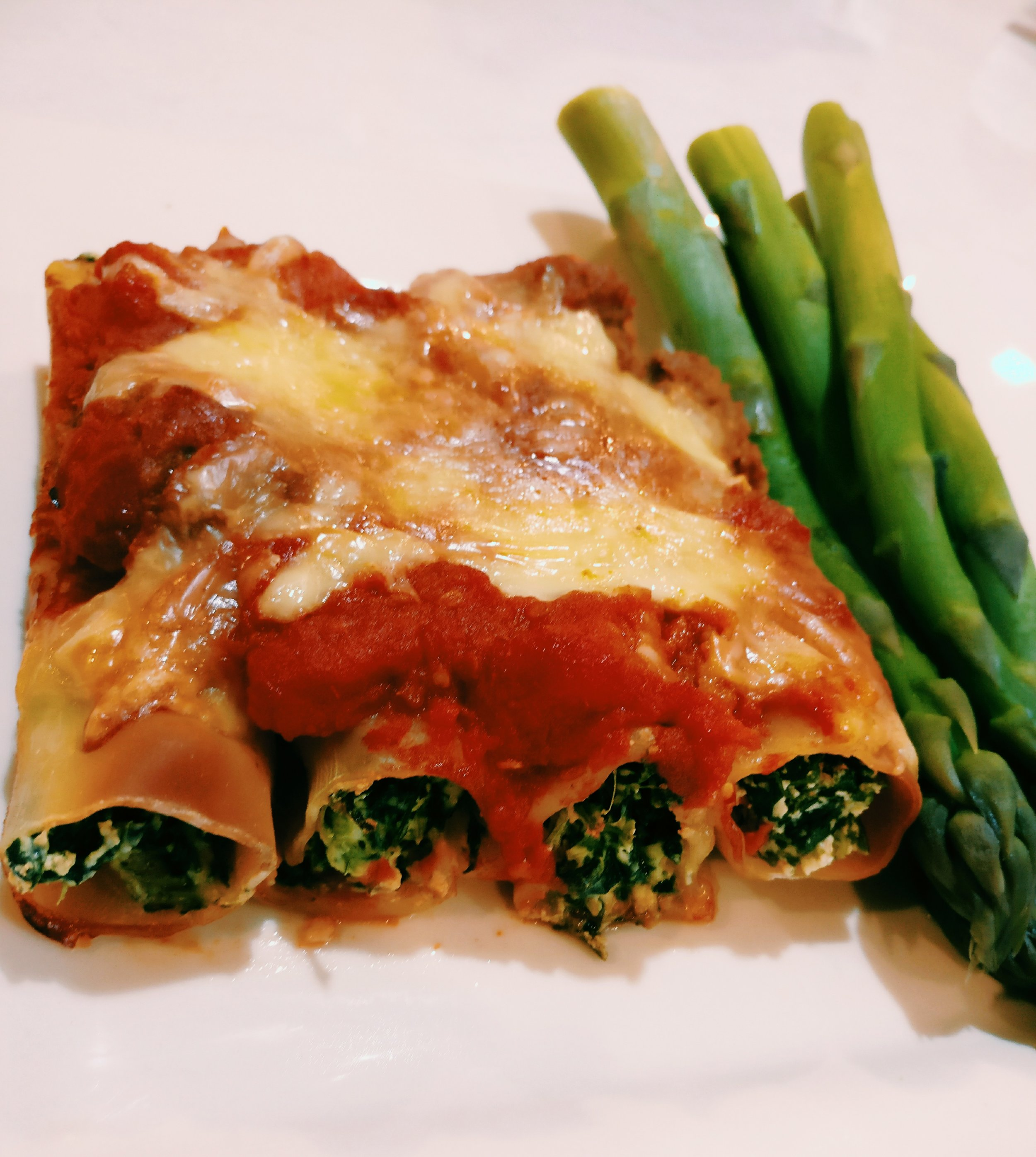 Vegetarian Cannelloni - Ingredients1 Can Chickpeas1 Can Lentils1 Can Chopped Tomatoes (chilli & herb)1/2C Water1/2 Onion - Diced1t Brown Sugar1T Soy Sauce250g Cannelloni200g Ricotta Cheese200g Spinach - Cooked1t Crushed GarlicSalt & Pepper1 Can Chopped Tomatoes in Juice1/4 C WaterGrated CheeseMethod1. Add the chickpeas, lentils, chopped tomatoes, onion, water, brown sugar and soy sauce to a slow cooker and cook on low for 4 hours2. Whizz the lentil mix in a food processor until it turns into a paste3. In a bowl, combine the ricotta cheese, spinach, garlic, salt and pepper4. Fill the cannelloni with with ricotta cheese mix and place in an oven proof dish5. Combine half of the lentil mix with the tin of tomatoes and water, pour on top of the cannelloni6. Sprinkle with the grated cheese and bake in the oven at 170 for 30-35 minutes or until the cannelloni is cooked though (you may need to add some more water throughout cooking if it looks like it is drying out)