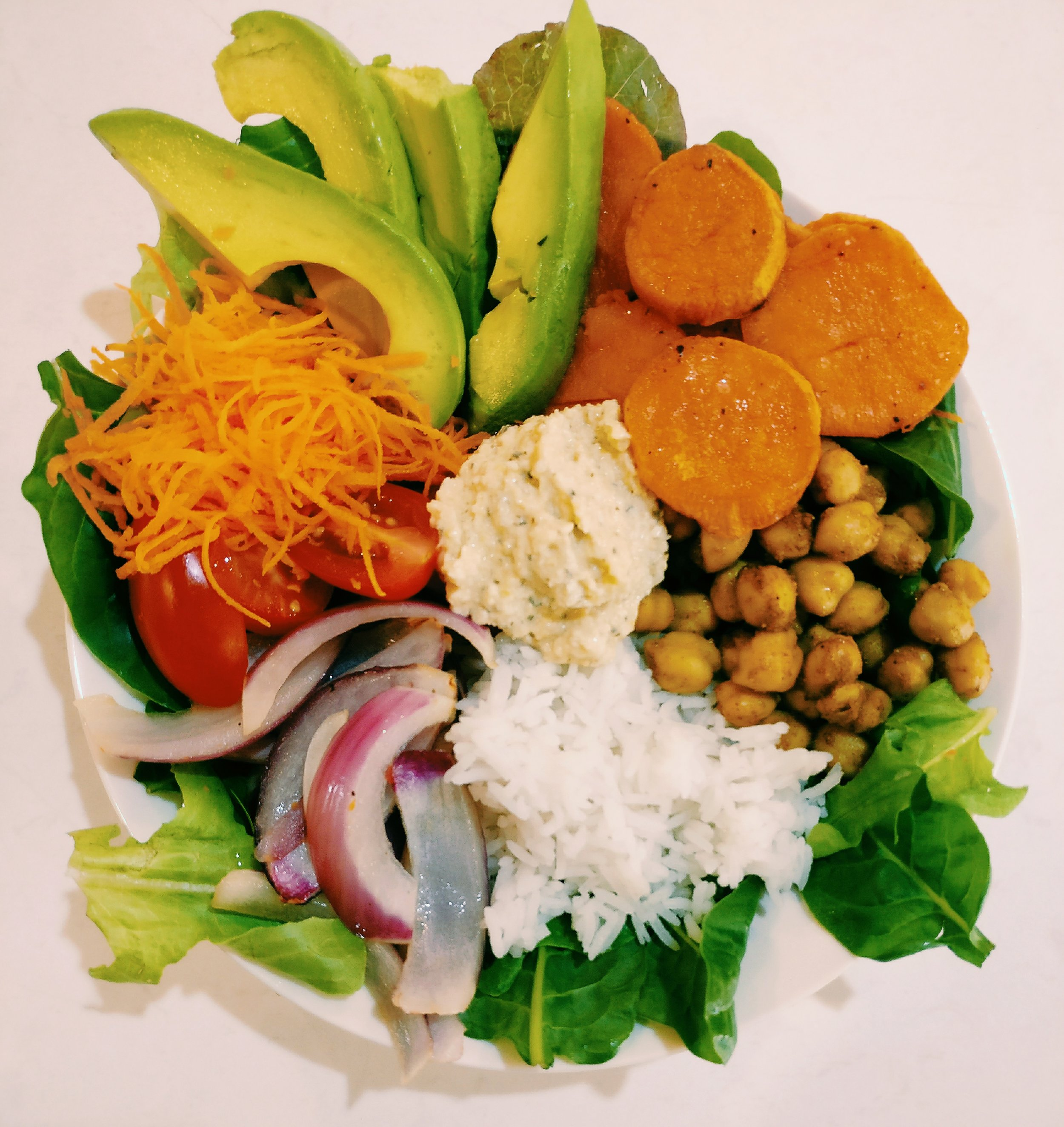 Nourish Bowl - Ingredients1C Rice - Cooked1 Can Chickpeas, Drained and Rinsed1C Lettuce leaves (spinach/rocket preferred)5 Cherry Tomatoes - Halved1 Carrot - Finely Grated1/2 Avocado - Sliced1 Kumara1 Red Onion - Sliced2T Coconut Oil1-2t Curry Powder2t HummusSaltPepperMethod1. Coat the Kumara & Red Onion in 1T Coconut oil, salt & pepper and roast in the oven for 30-35 mins at 180 (the onion won't take as long as the Kumara)2. In a frying pan, melt 1T of Coconut oil, add the chickpeas and toss to coat, add 1-2t of curry powder and toss to coat, heat through for 1-2- minutes3. Cook the rice according to packet directionsAssemble the Buddha Bowl1. Start by using the lettuce leaves to frame the bowl, scatter around the outside of the bowl2. Make small piles of the other ingredients around the bowl and lastly place of big dollop of hummus or dressing in the center of the bowl.3. You can mix and match any similar ingredients and add meat if you prefer