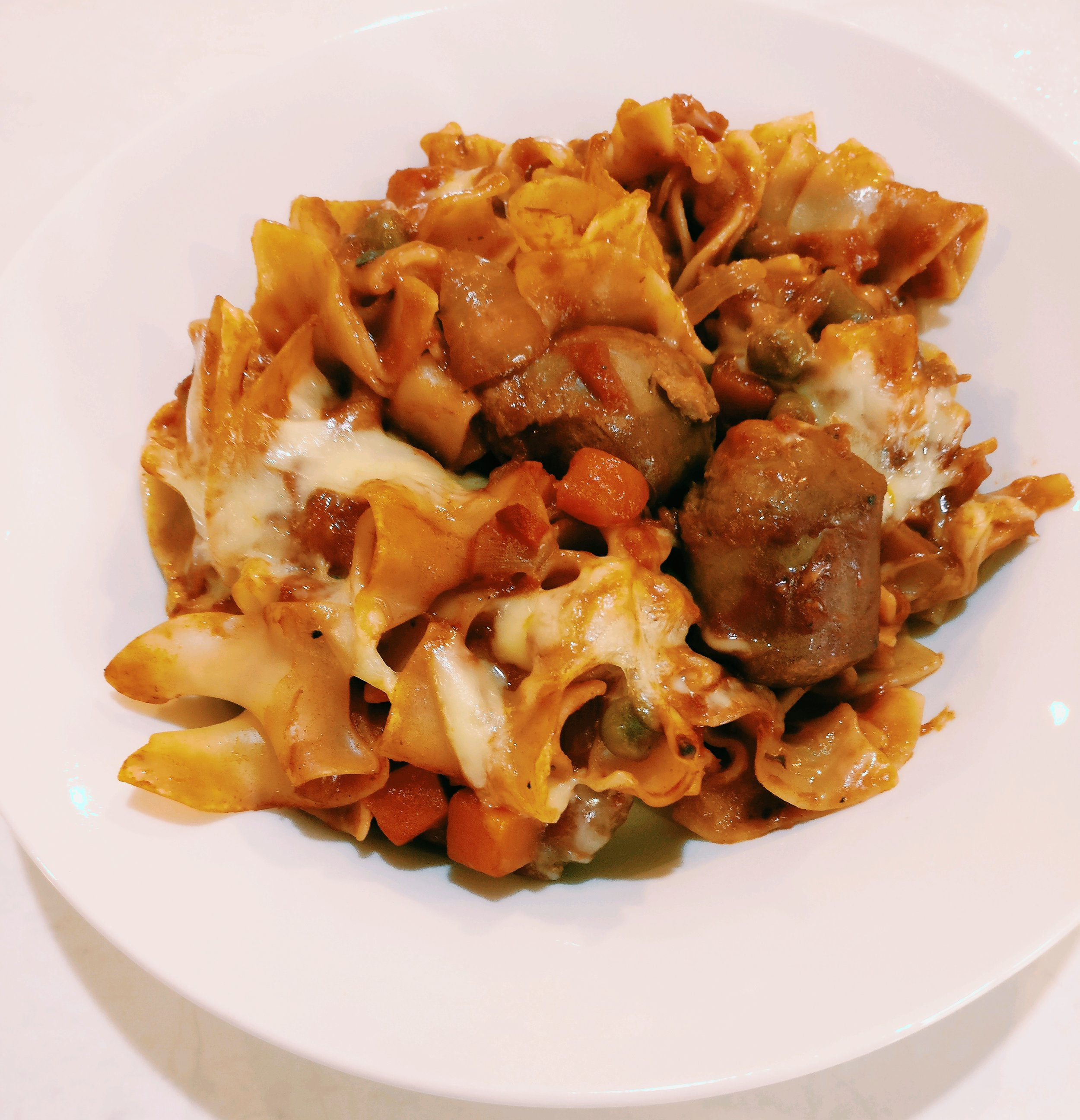 Sausage Pasta Bake - Ingredients3 Sausages - Chopped into quarters1/2 Onion - Diced1C Frozen Veges1/2 Can Tomatoes1 Can Pasta Sauce150g PastaGrated CheeseMethod1. Brown the Sausages and Onion in a frying pan2. Add the frozen veges, tomatoes and pasta sauce to the frying pan and cook through for 5 mins3. Cook the pasta according to packet diretions4. Combine the cooked pasta and sausage mixture and pour into an oven proof dish5. Top with a small amount of grated cheese6. Bake in the oven at 180 until browned on the top