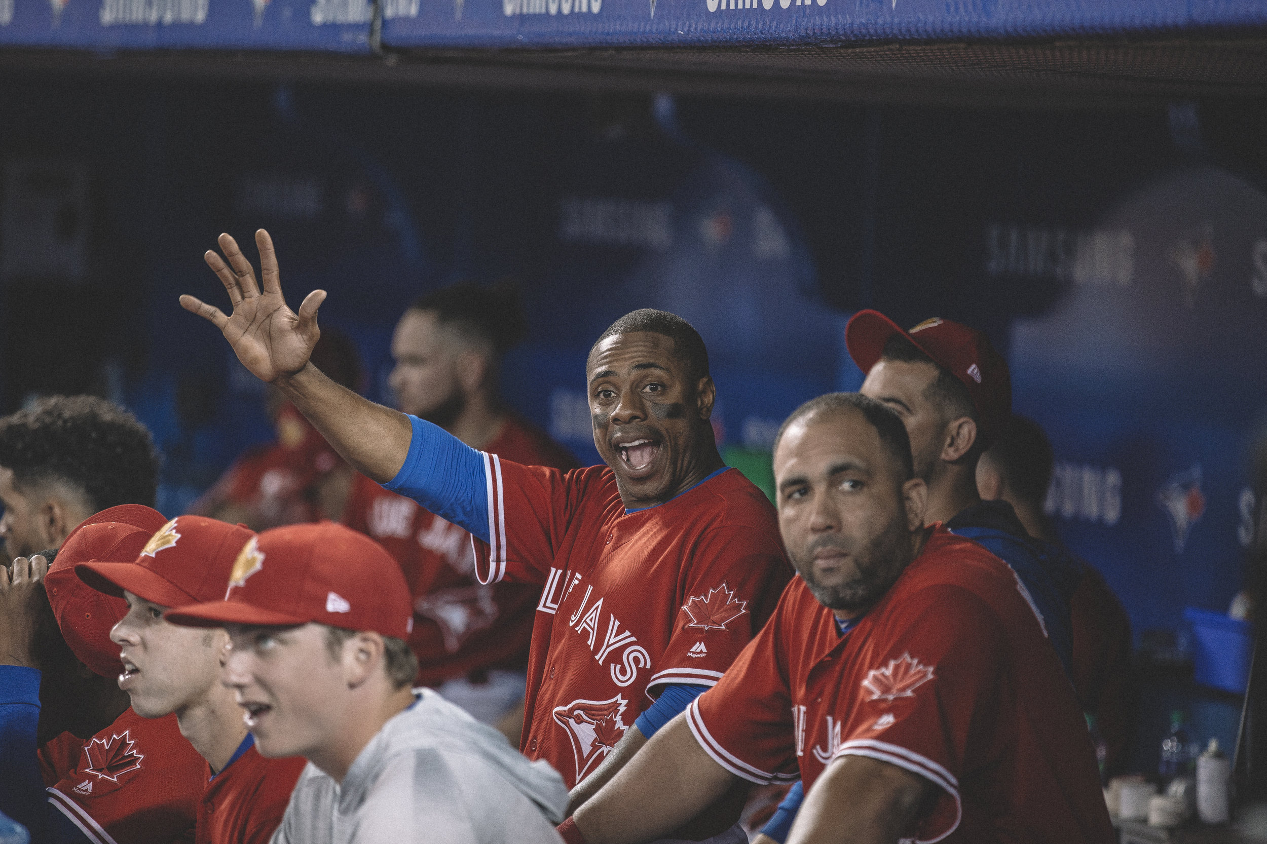 Curtis Granderson Jr. waving from the the Blue Jays dugout