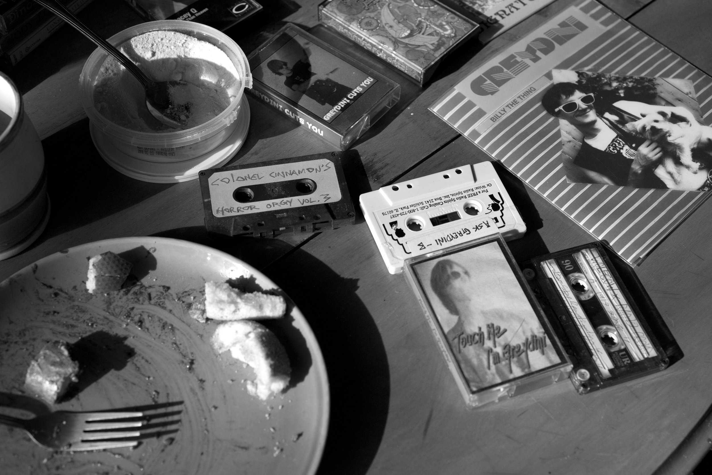 Empty plate beside some cassette tapes