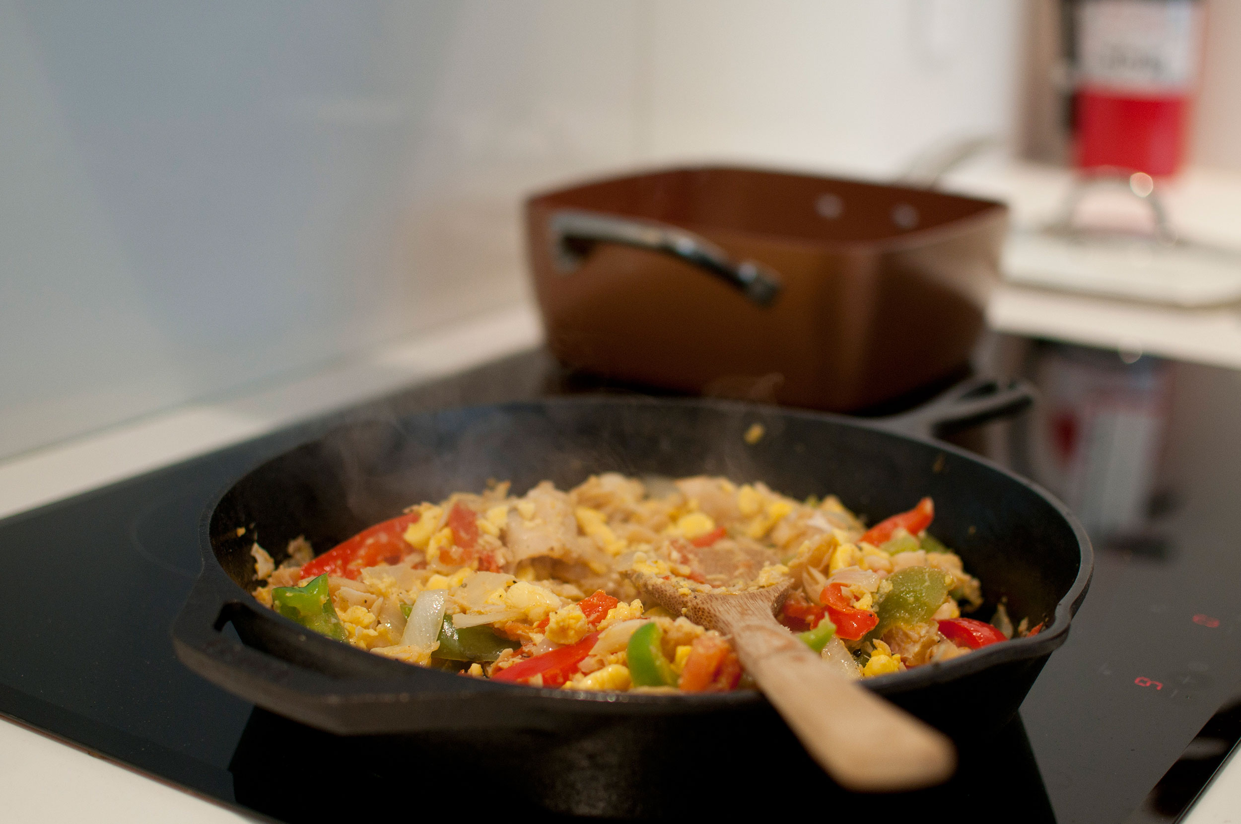 Food cooking in a skillet