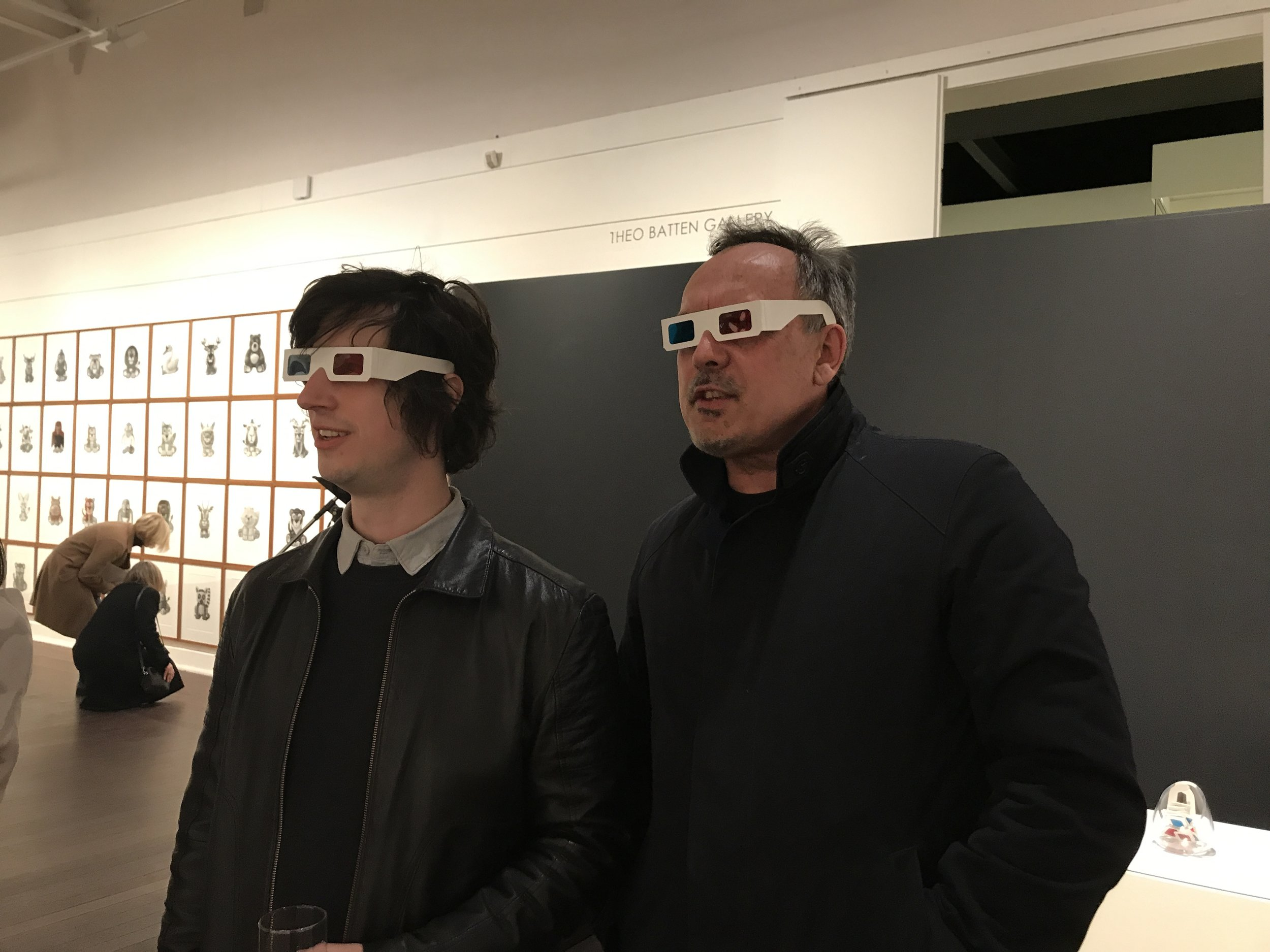 Fellow exhibiting artists Tony Curran and Michael Kempson enjoying the optical illusion of my work  Ocularanagluphos  in  Aura: Repetition, Reproduction, and the Mark of the Artist