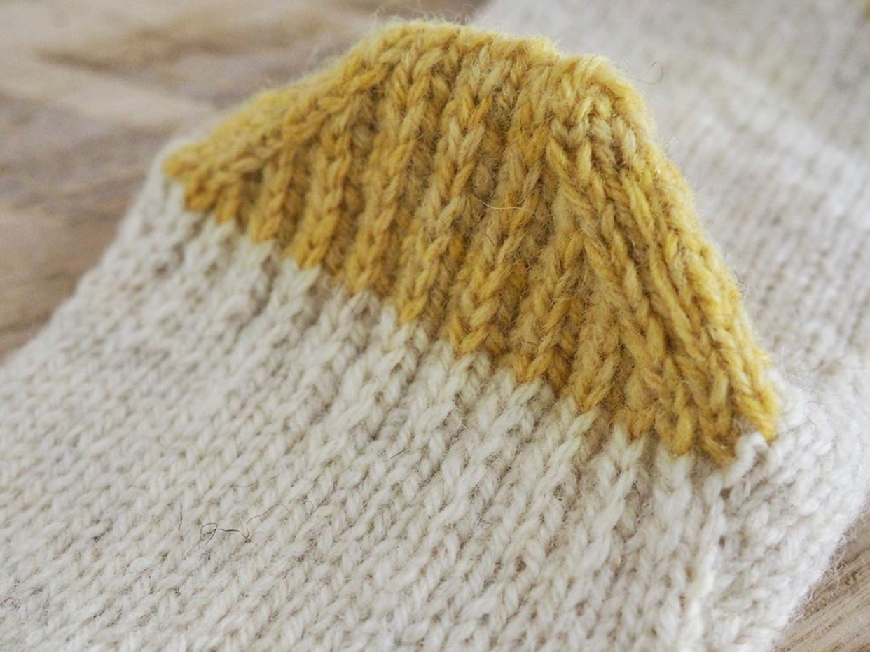Caring for natural wool socks can include reinforcing your heel, knitting an afterthought heel (pictured above) or eventually just mending your sock. (Photo: Flossi Knits)
