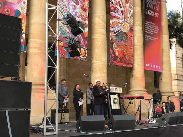 Ku Arts Anangu Mayatja, Alison Milyika Carroll, gives an opening address in Pitjantjatjara language at the opening of TARNANTHI Festival of Contemporary Aboriginal and Torres Strait Islander Art, Art Gallery of South Australia, 2017. Photo: Ku Arts