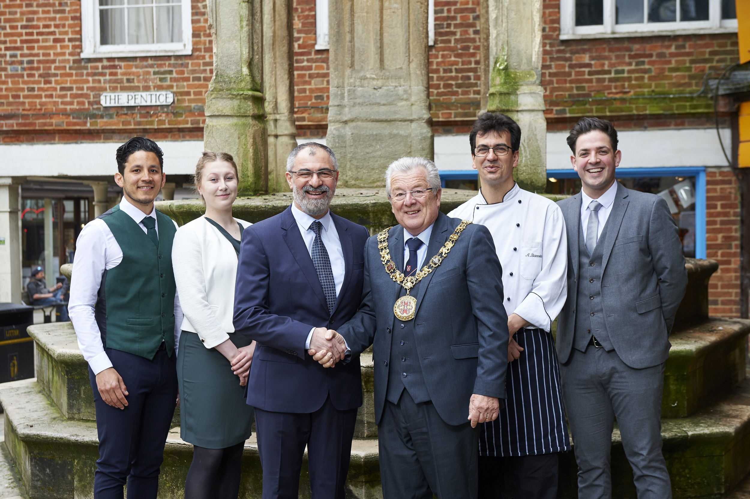 (L-R) general manager, Reza Najafi, head chef, Luis Gonzales and The Ivy Winchester Brasserie team welcomed by the Mayor of Winchester, Cllr David McLean