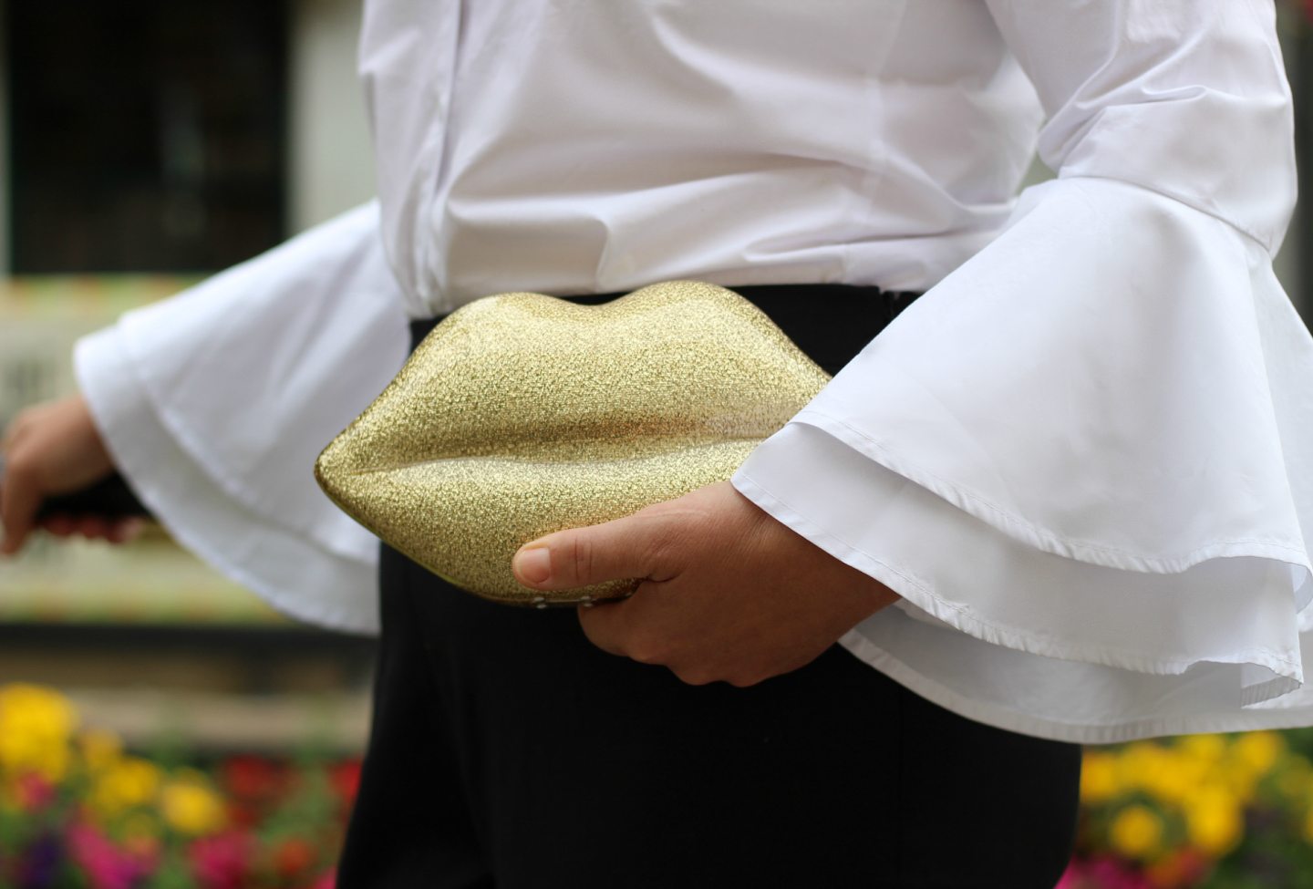 - A photo from my recent shoot for my wife's blog taken on a cloudy day in Enfield. I'm particularly pleased with how this picture came out. I like the movement of the sleeves and how the bag is catching the light.