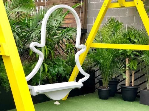 The first ever Snap House at SXSW 2019 had its own playful take on a swing, using the familiar Snapchat logo. Image via    Hubspot   .