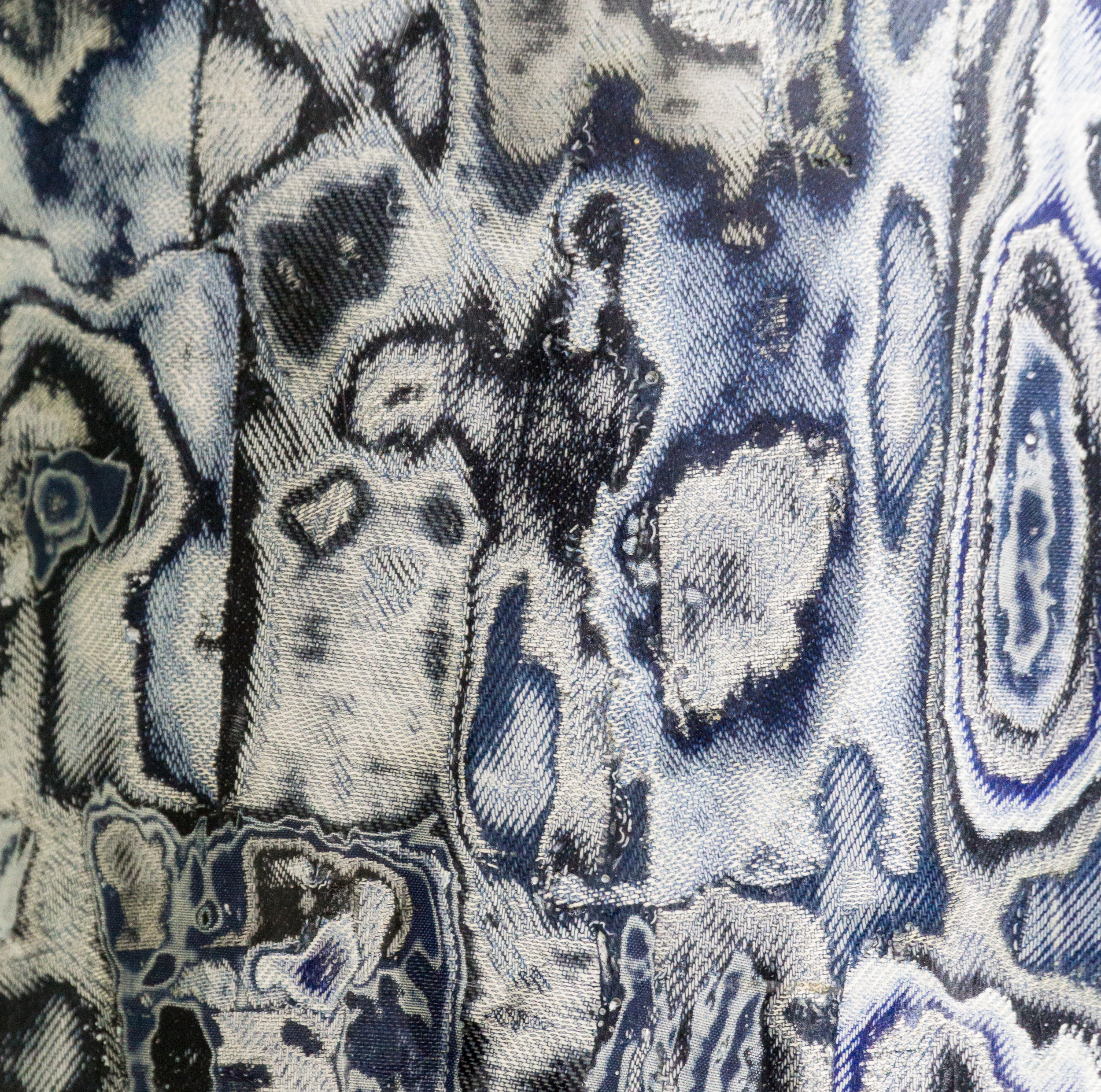 Bahia Denim by Sophie Rowley Waste material: Post-industrial denim waste    Bahia Denim is created using production waste from the fashion industry. These textile offcuts are layered, adhered and carved to create intricate patterns. The non-standardized nature of the waste - the variation in size, shade, color and texture make the designs unique. In developing the material by hand endless color combinations can be explored achieving customized and one of a kind designs. The lightweight yet durable properties of the material allow for diverse applications in furniture, wall paneling or interior surfaces.   sophierowley.com