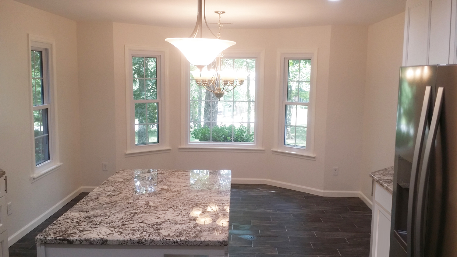 Interior Painting - Beautiful new kitchen with detail painted trim..