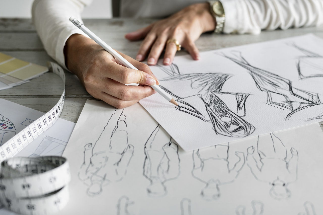 Woman sketching clothing designs