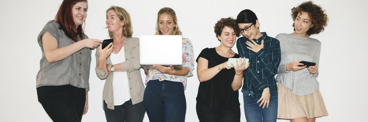 Group of Women holding computers and smartphon