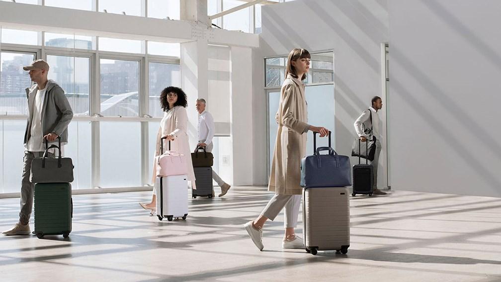 People walking with luggage