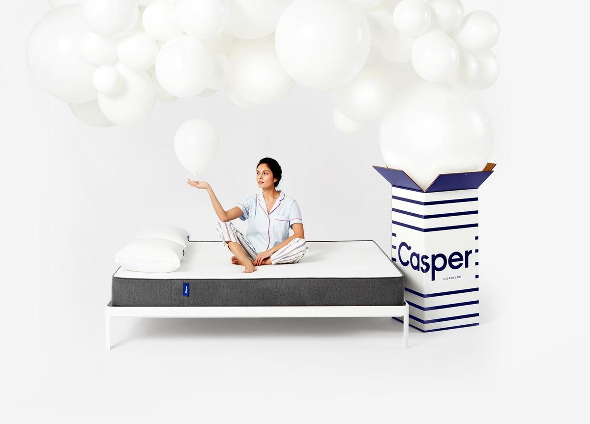 Woman sitting on a mattress
