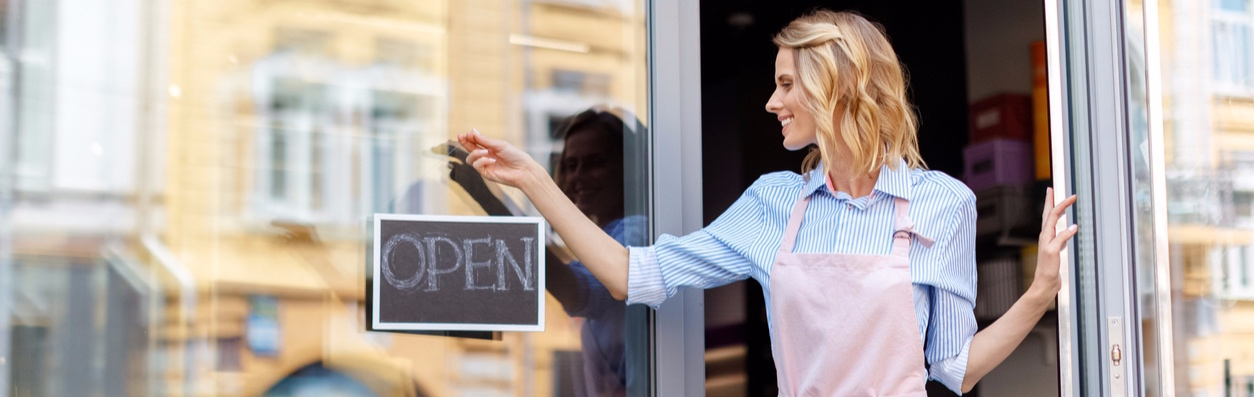 Woman Opening Retail Store