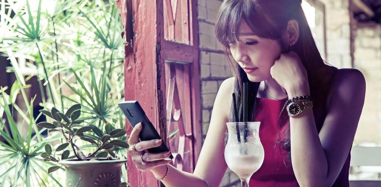 Asian woman looking at phone