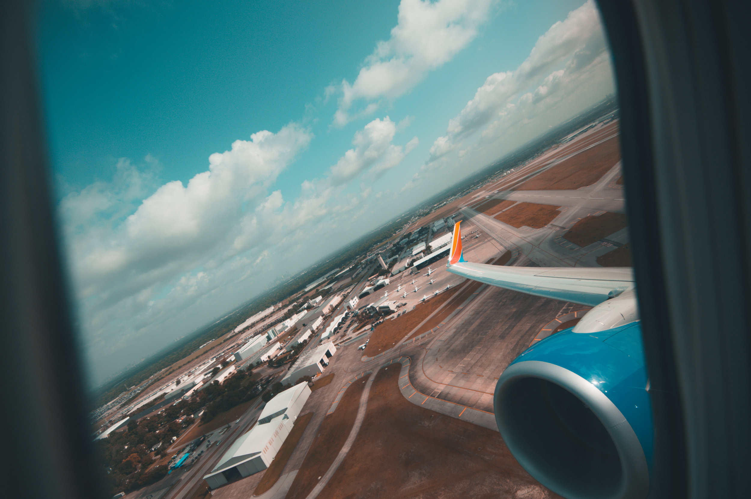 I took this shot on my flight home from Houston, I had flown home for a few days to go to the funeral of a friend who had passed away. I had to say goodbye to someone who was very influential to me and within all of that I realized home isn't really home anymore. The whole trip is still so weird to me.