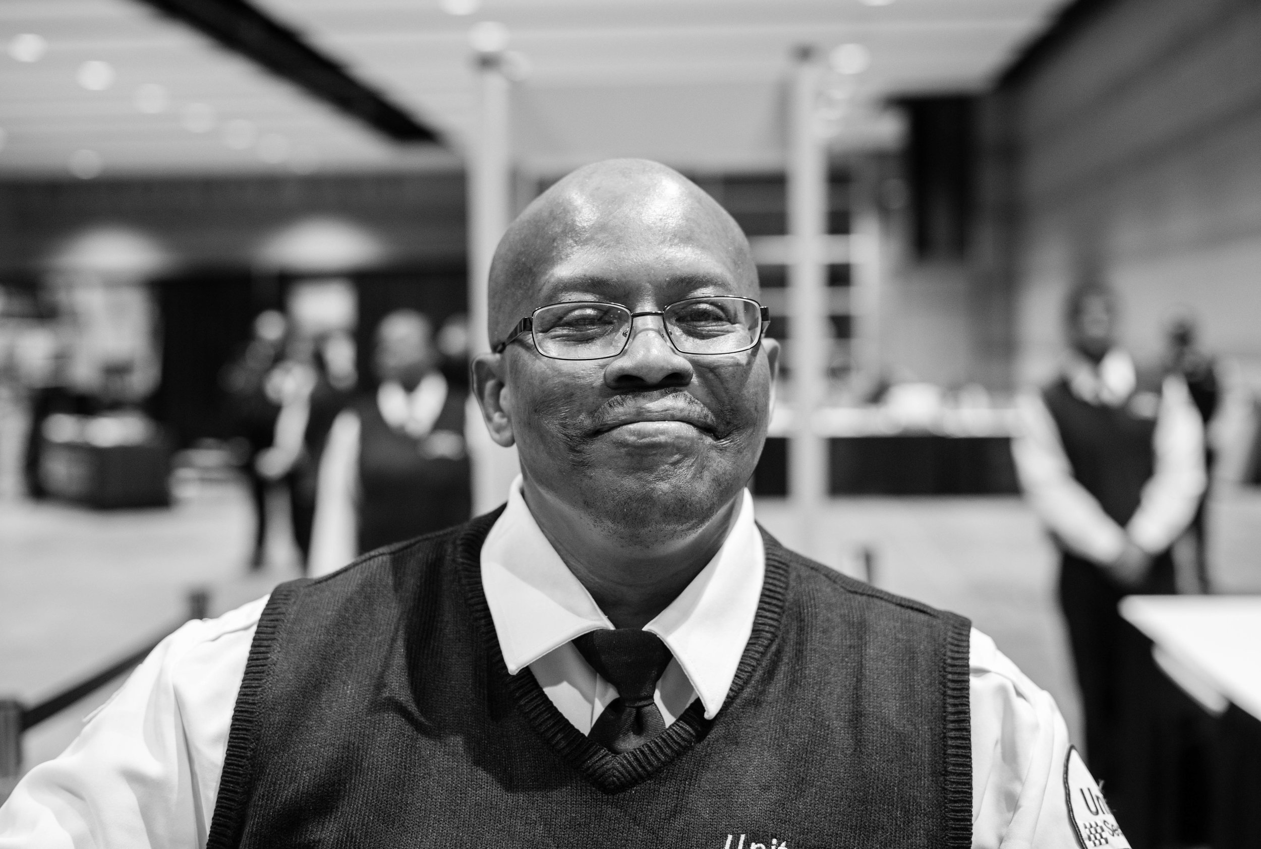 Leonard was the event staff for the convention center. He had this amazing smile that he couldn't shake. He told me as a Christian it makes him so happy seeing all of these future saints walking by,