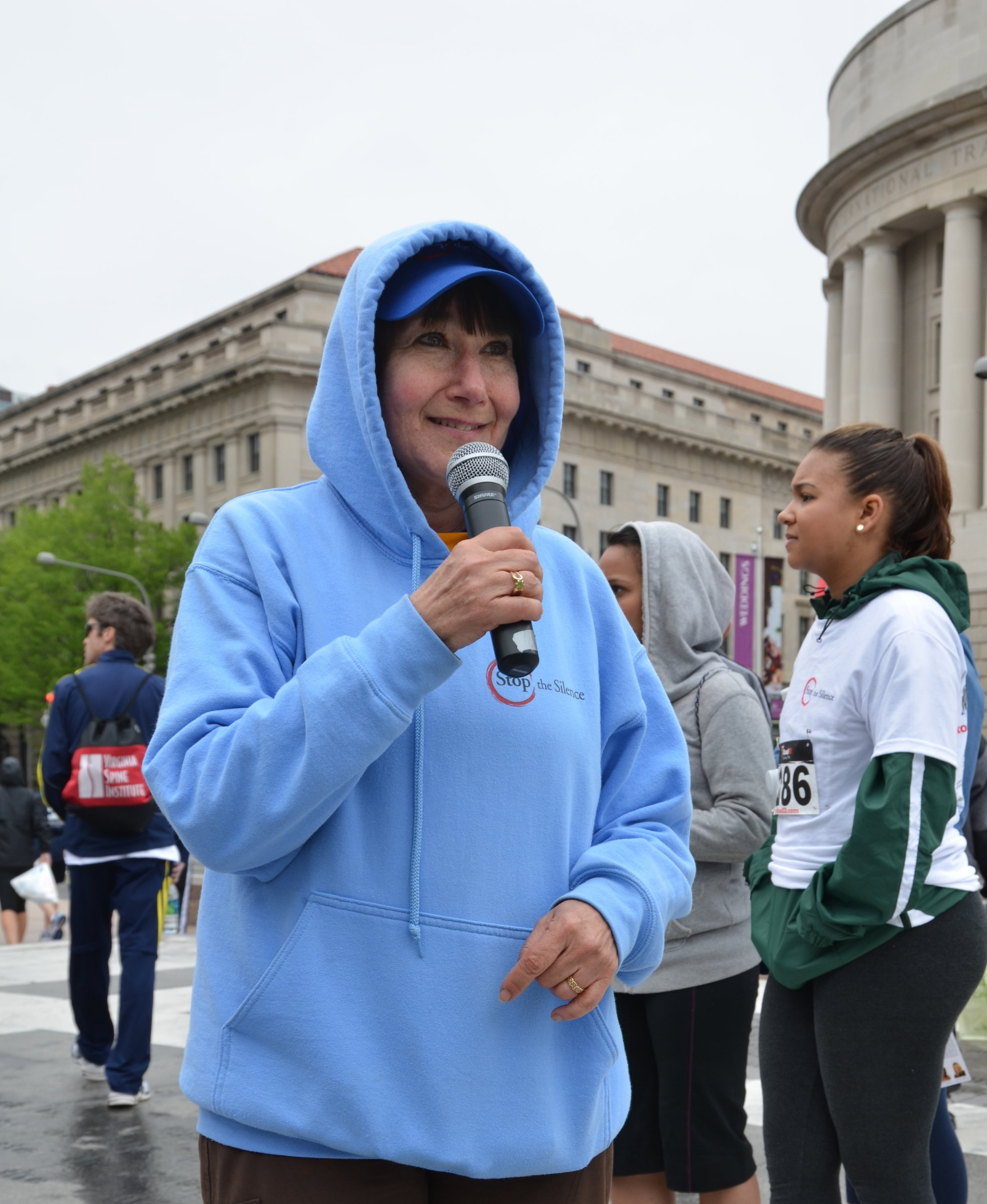 Pamela has organized and presented at numerous events locally, nationally and internationally. Here, she is speaking at the Race (and Walk) to Stop the Silence in 2012. The Race was the result of research she designed and conducted with another professor (Bey Ling Sha, UMD). The Race DC took place for 10 years in the heart of DC and attracted more than 1,200 runners and walkers. Races and Walks have taken and still take place in various states and other countries. These events have provided major advocacy through media and on the streets to increase awareness about CSA.