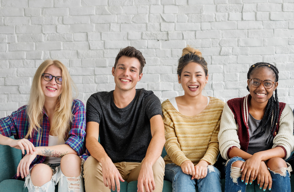 Canva - Diverse Group People Sitting Couch Concept.jpg