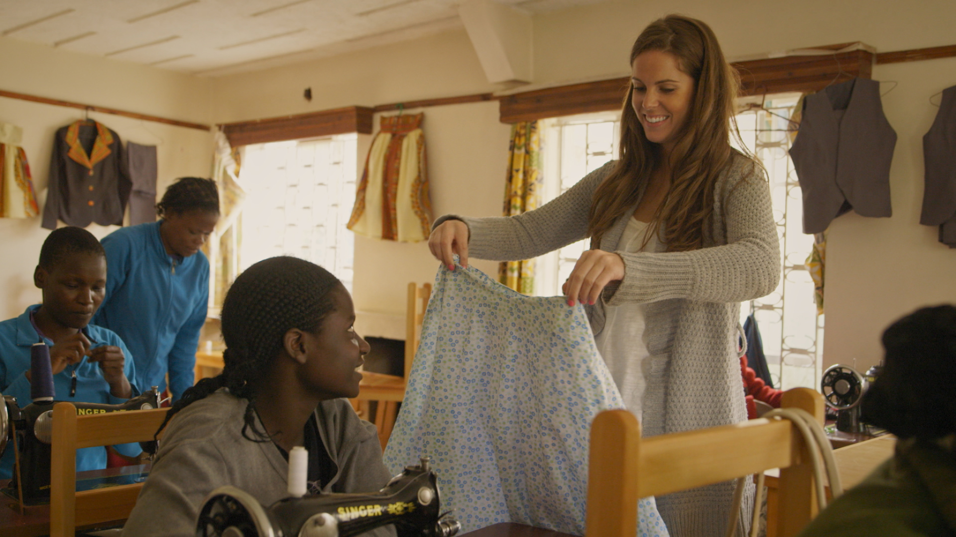 """American fashion designer Anna Taylor works with women in Nairobi, Kenya to teach them valuable seamstress skills to support themselves while creating her clothing line, Judith&James. Anna is one of four artists profiled in the film """"Little Stones"""". PHOTO: Courtesy """"Little Stones"""""""