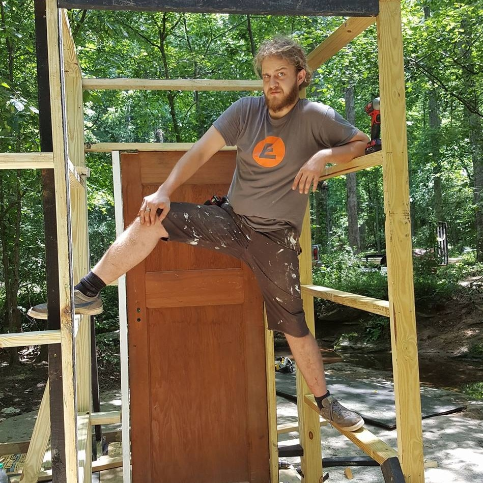 John Cable - Wood Shop Supervisor [He/Him] 💖 John manages tools, teaches workshops, and supervises members of Cut Cake Factory, Bakie's community wood shop. He's an Atlanta native and has been a fabricator and carpenter since 2013. He really likes dogs and eats too much pizza. Come say hi and bring him a slice!